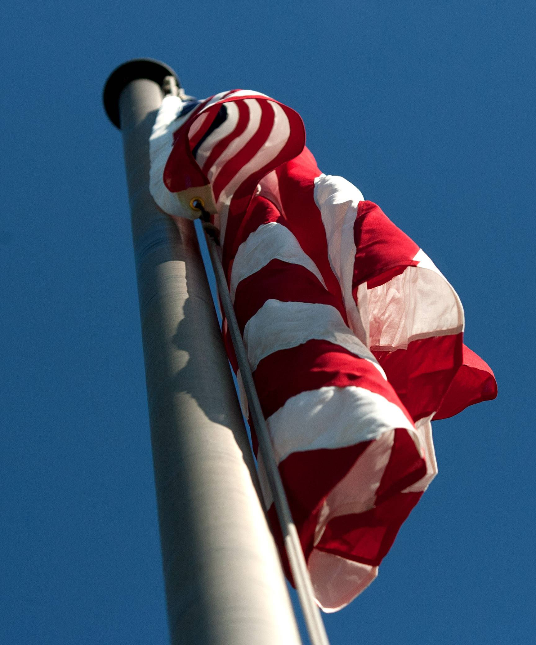 A new American flag is flying outside St. James the Apostle School in Glen Ellyn.