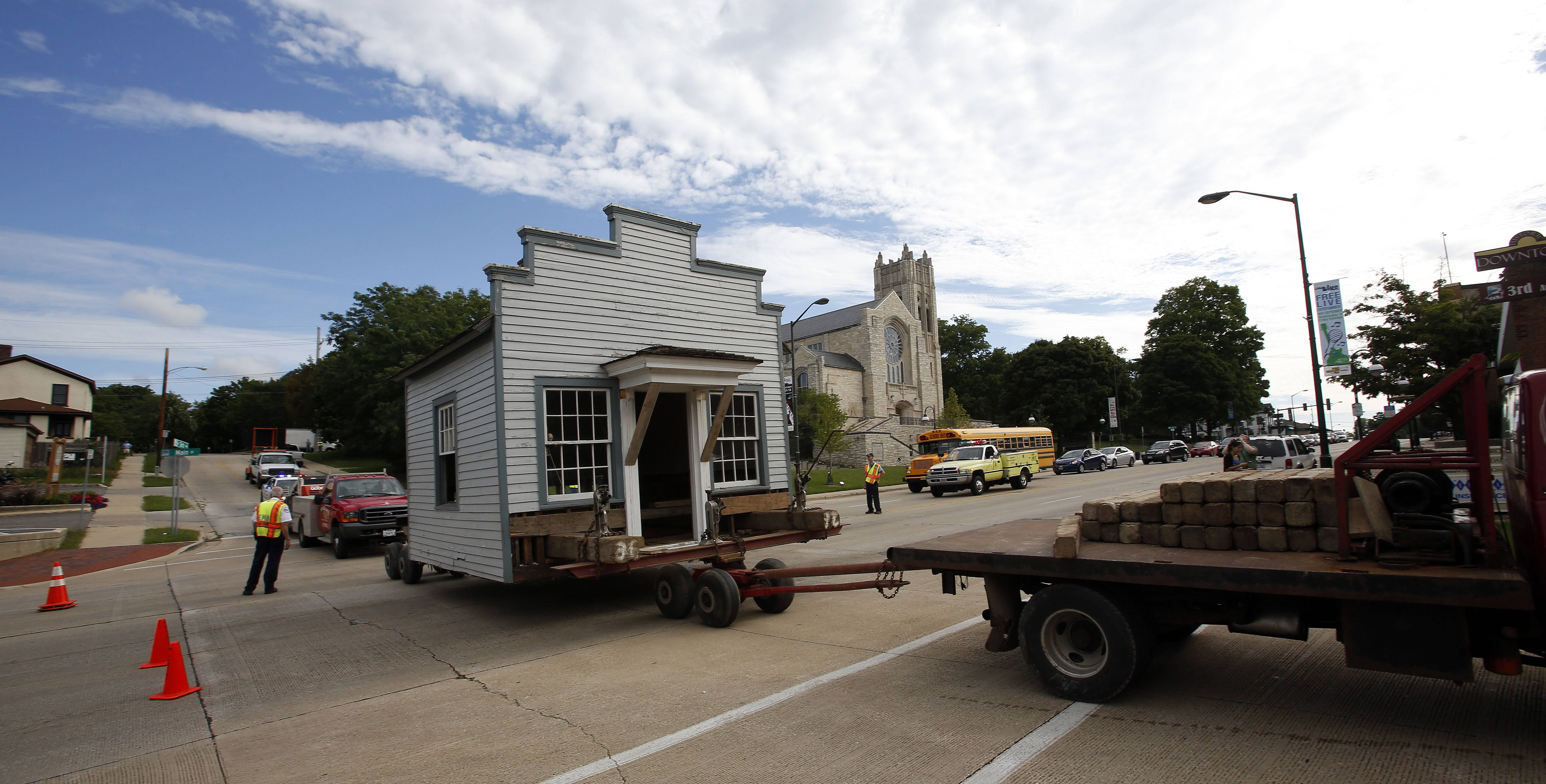 The historic Jones Law Office building crosses Main Street in St. Charles Wednesday en route to its new location in Langum Park along Route 25 near Devereaux Way.