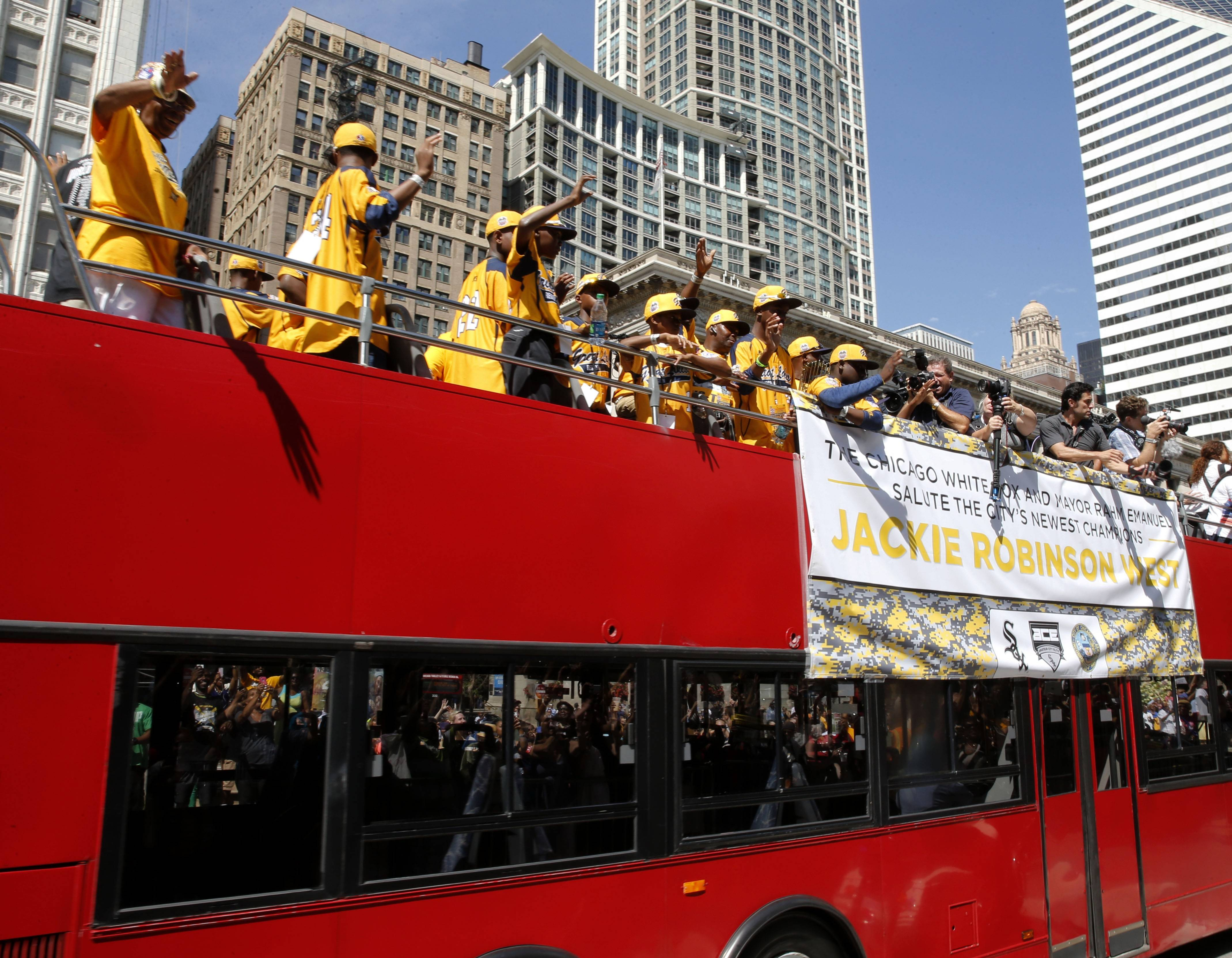 Members of the Jackie Robinson West All Stars Little League Baseball team participate in a parade and rally celebrating the team's U.S. Little League Championship Wednesday in Chicago.