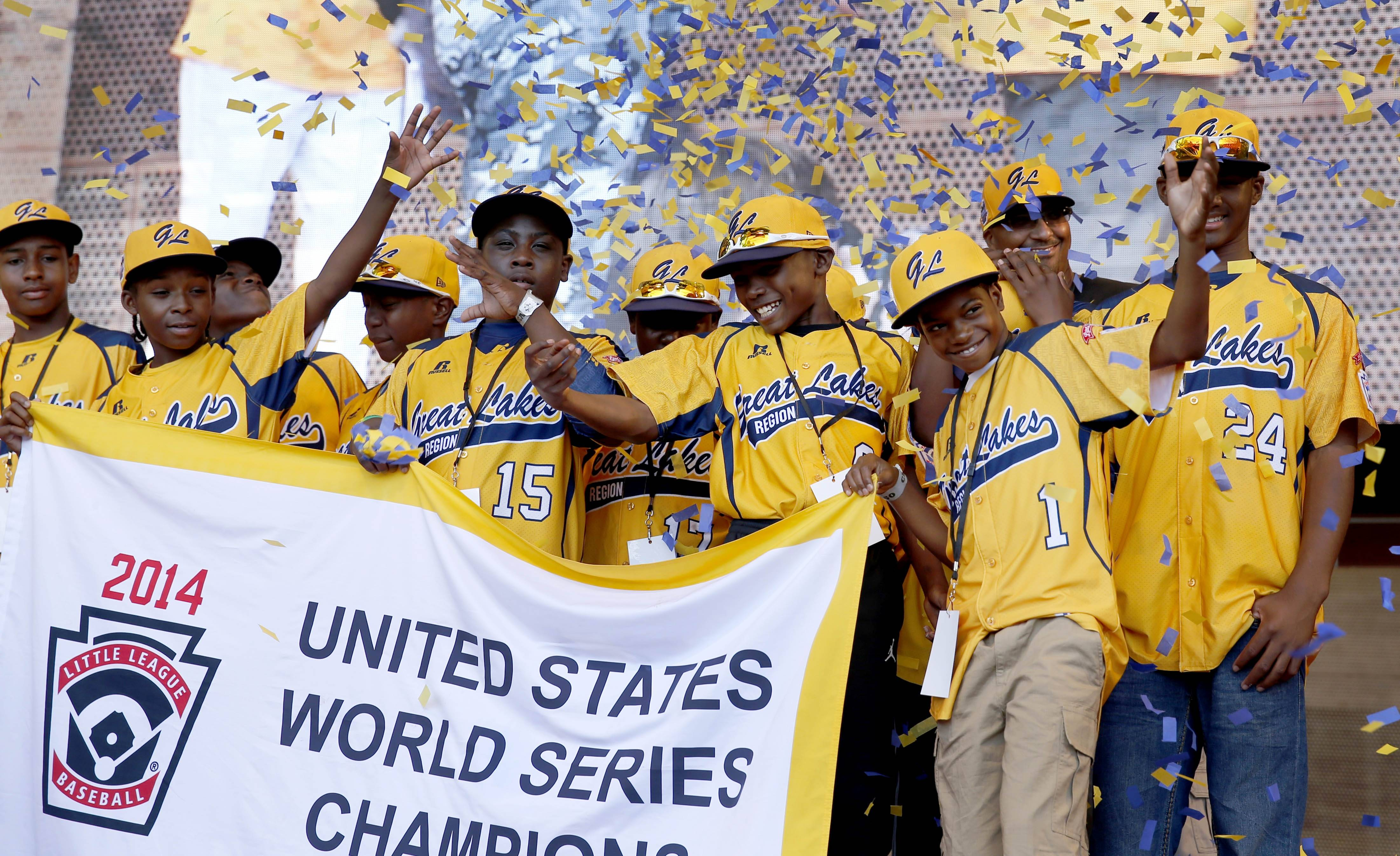 Members of the Jackie Robinson West All Stars Little League Baseball team participate in a rally celebrating the team's U.S. Little League Championship Wednesday in Chicago.