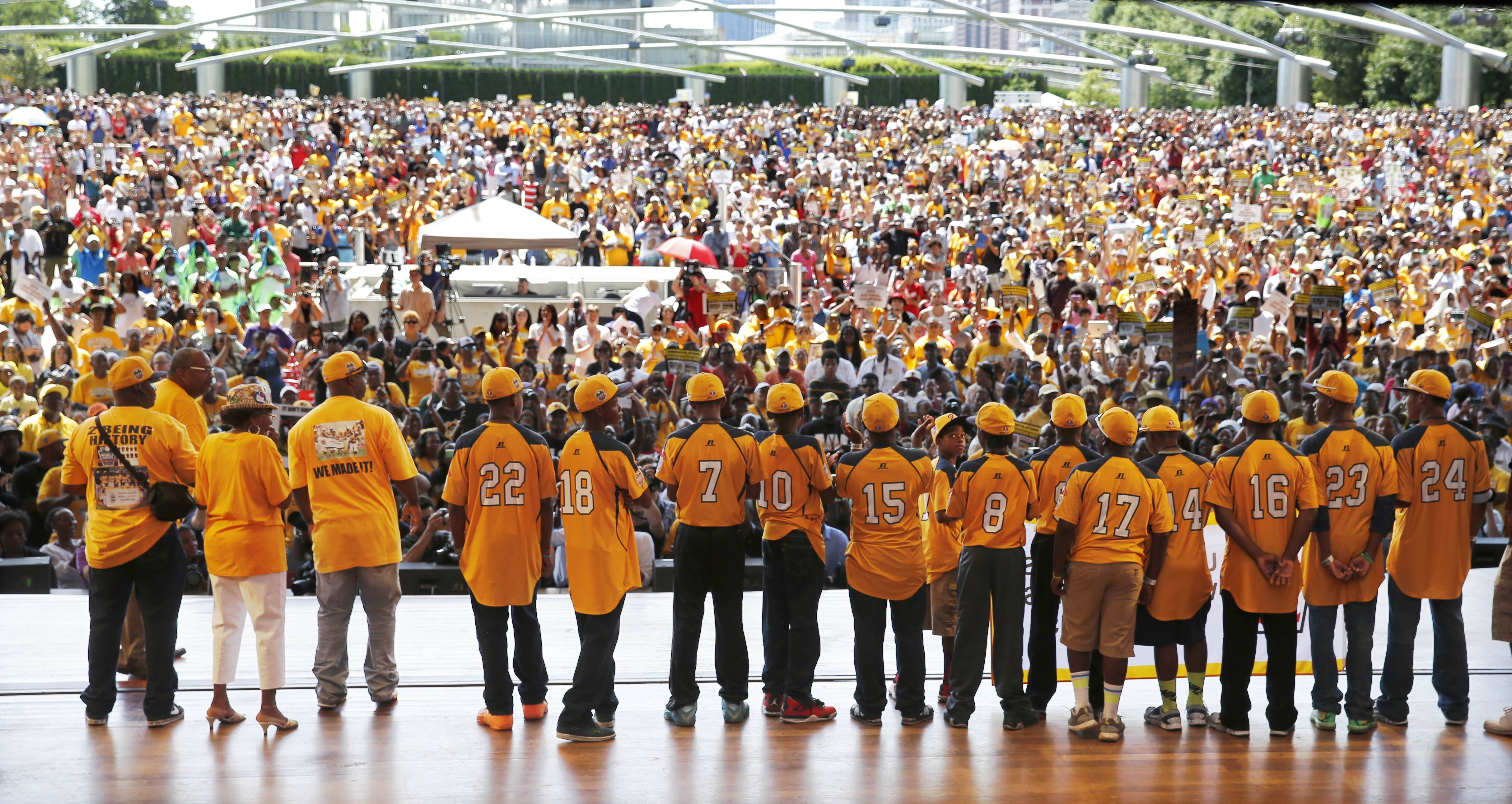 Members of the Jackie Robinson West All Stars Little League Baseball team participate in a rally celebrating the team's U.S. Little League Championship Wednesday at Chicago's Millennium Park.