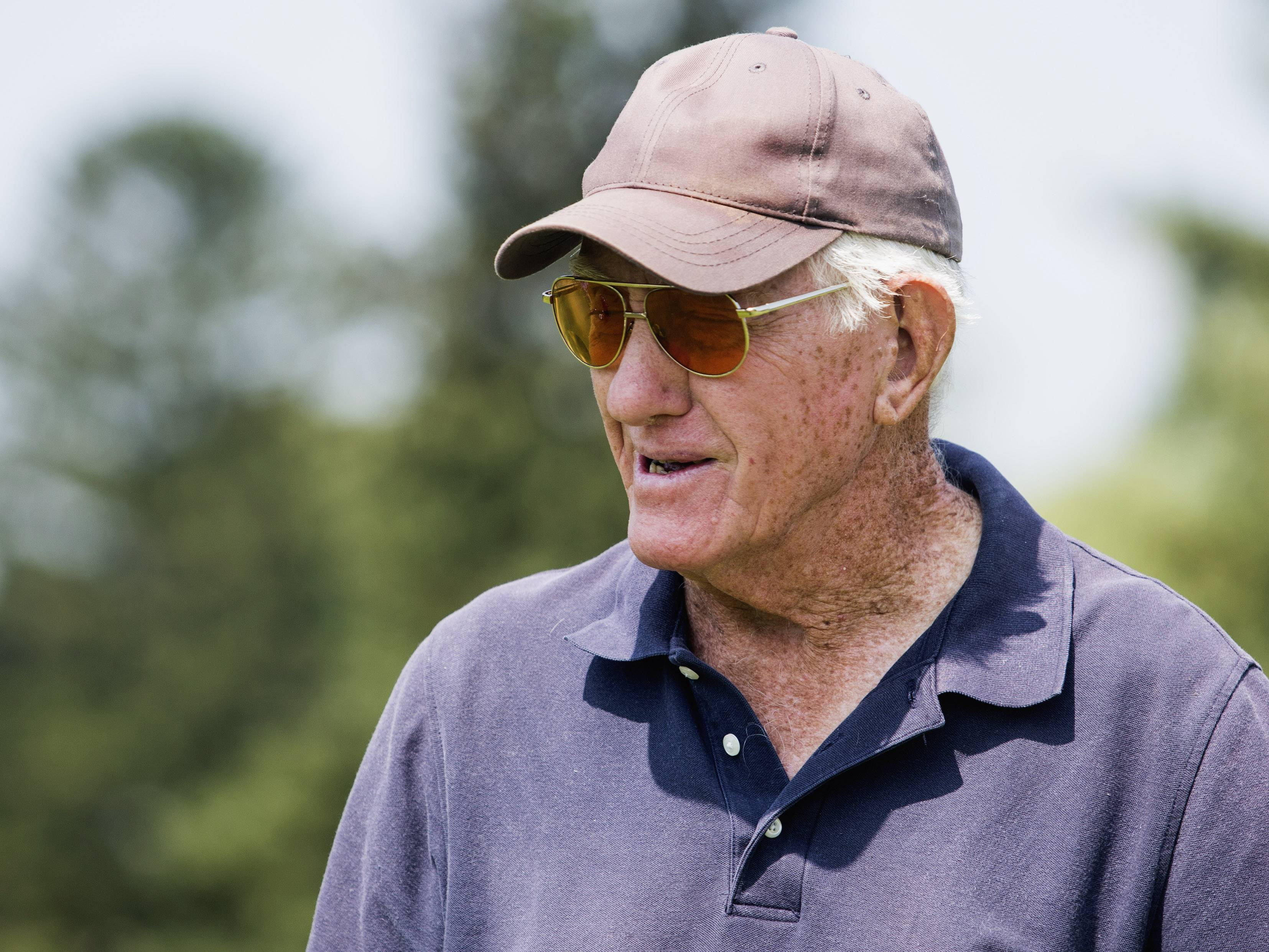 Lowell Parrish, 82, talks to other players before teeing off on the second hole at Elliot Golf Course in Rockford,