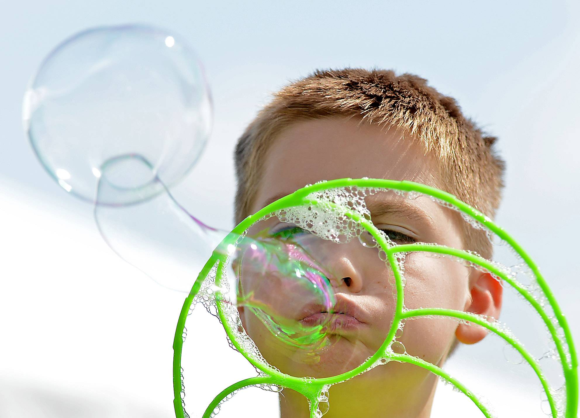 John Lelonek, 8, of Lake in the Hills blows bubbles at the Kids' Korner at a previous Summer Sunset Festival.