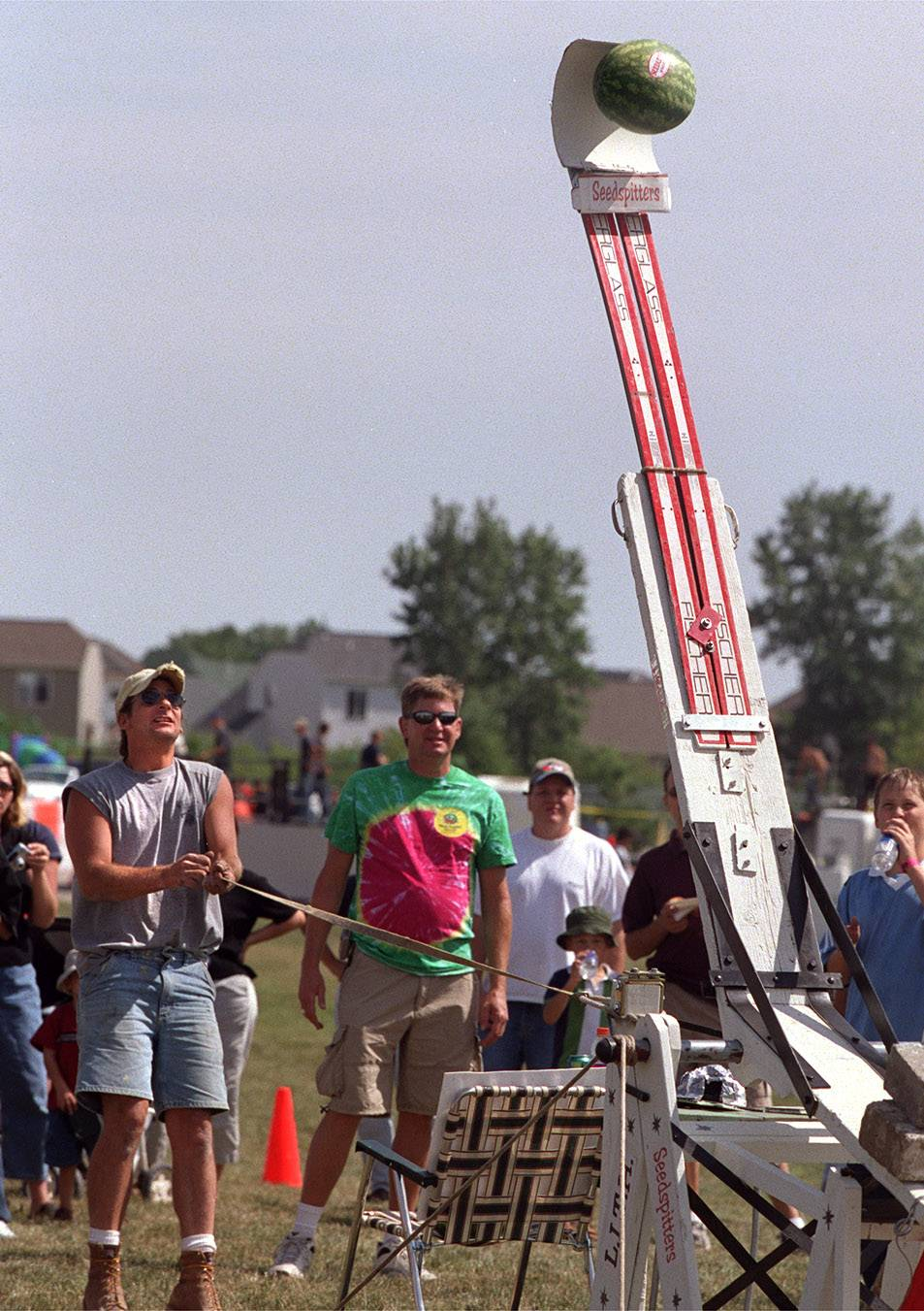 The Melon' Propellin' Contest, in which teams compete to launch watermelons as far as they can, is a popular event at Lake in the Hills Summer Sunset Festival.