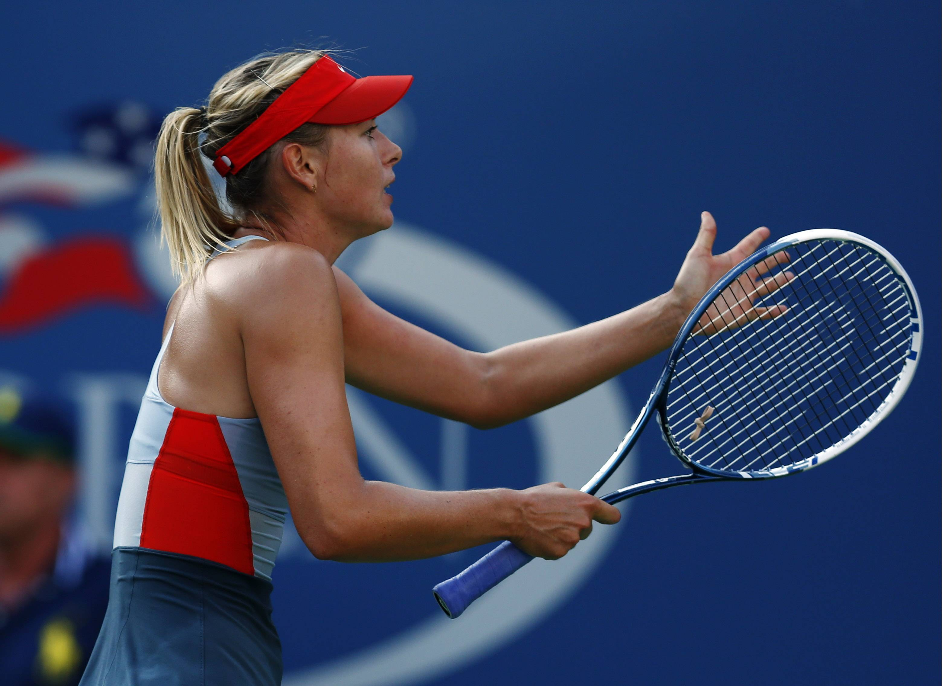 Maria Sharapova, of Russia, motions to the umpire during the second set against Alexandra Dulgheru, of Romania, during the second round of the 2014 U.S. Open tennis tournament, Wednesday, Aug. 27, 2014, in New York.
