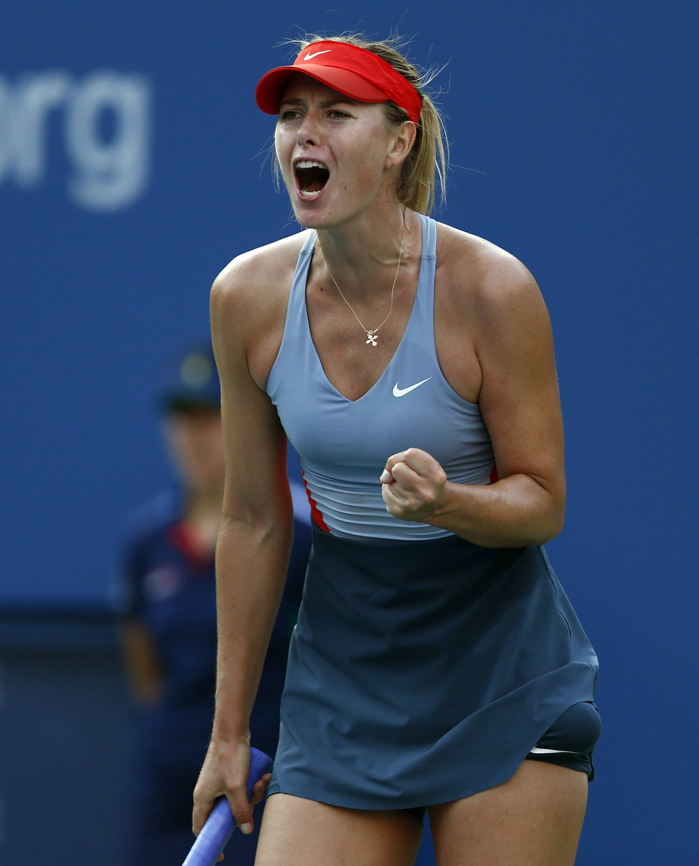Maria Sharapova, of Russia, reacts after a point against Alexandra Dulgheru, of Romania, during the second round of the 2014 U.S. Open tennis tournament, Wednesday, Aug. 27, 2014, in New York.