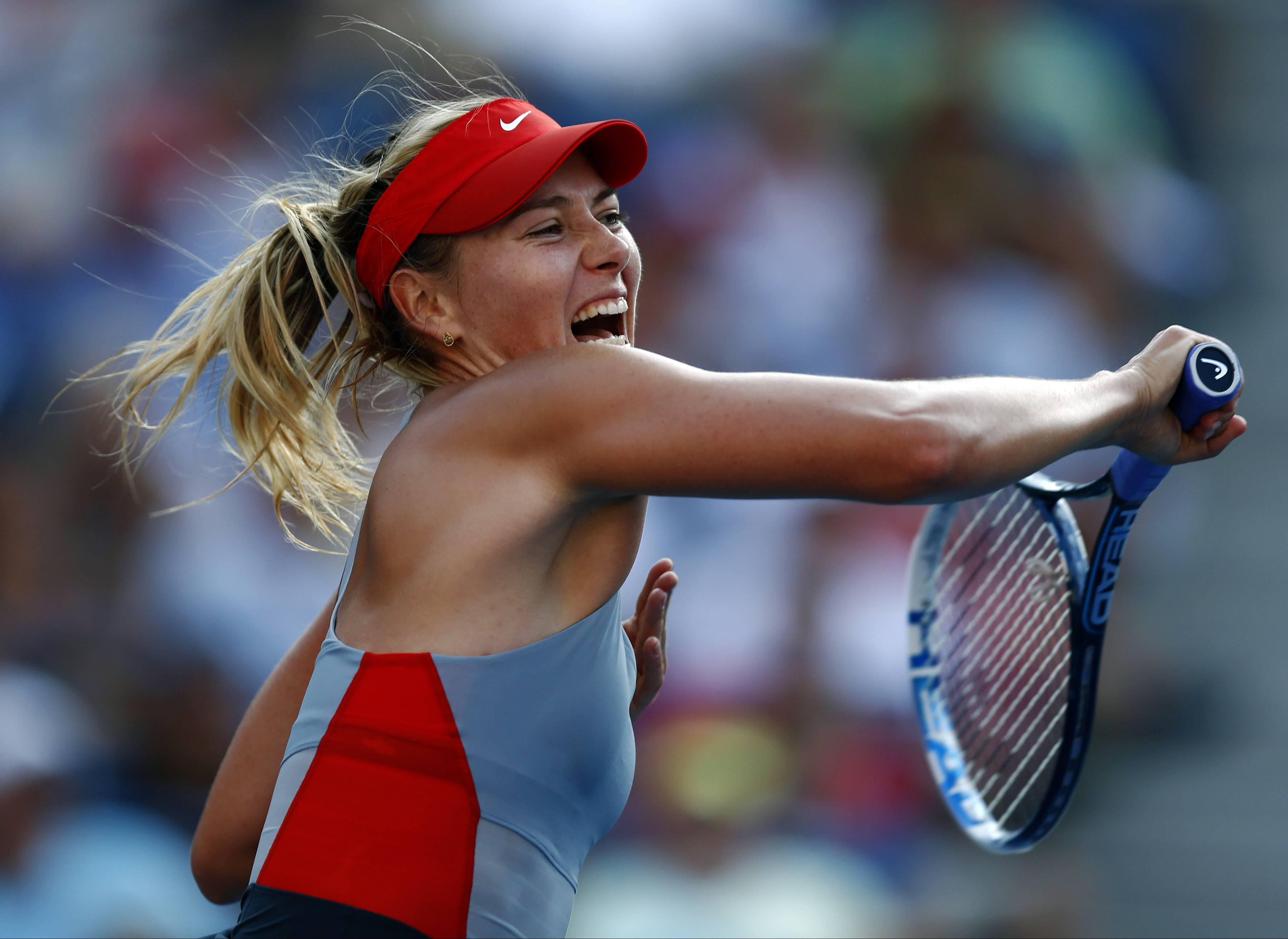 Maria Sharapova, of Russia, follows through on a shot against Alexandra Dulgheru, of Romania, during the second round of the 2014 U.S. Open tennis tournament, Wednesday, Aug. 27, 2014, in New York.