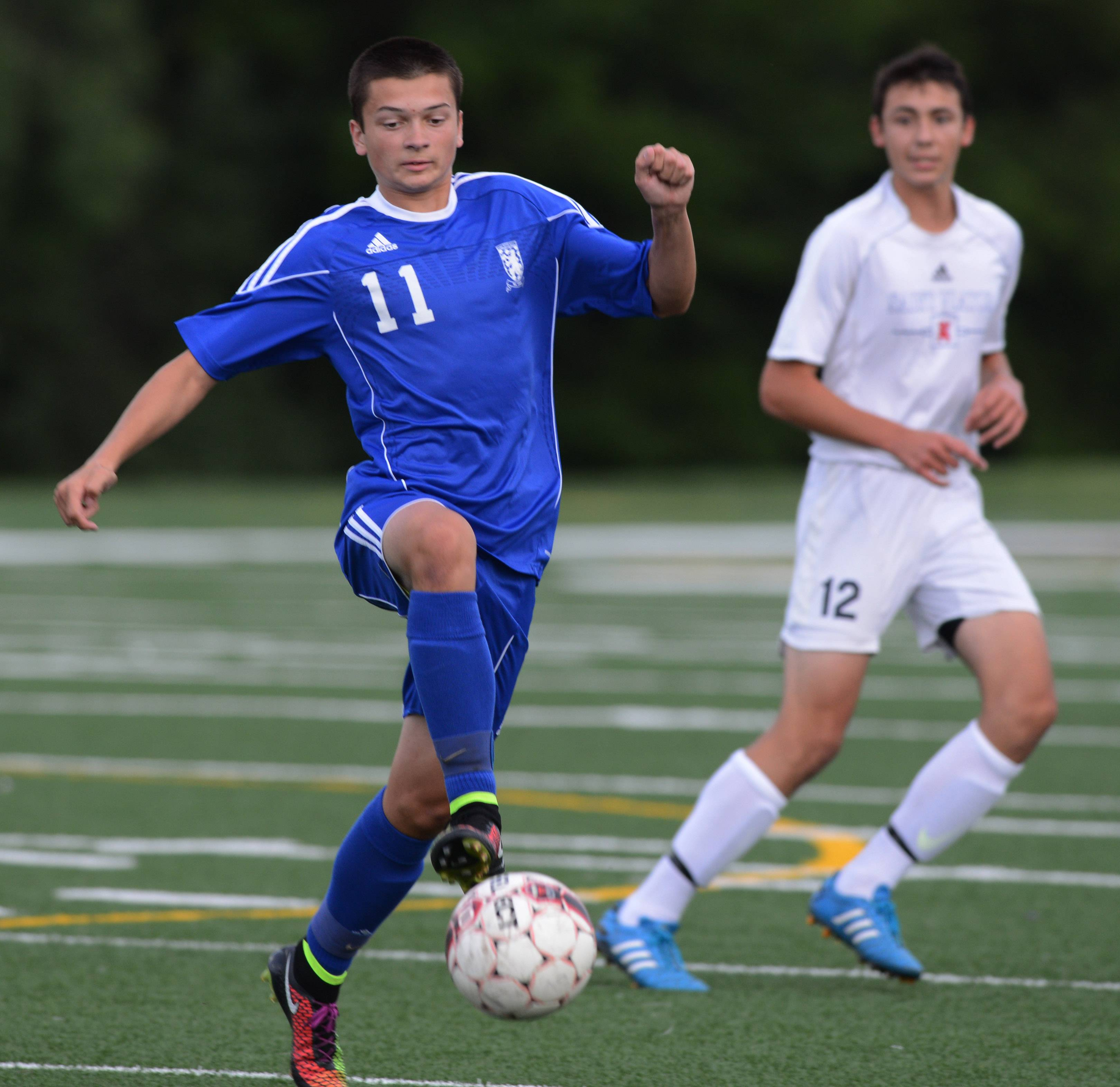 Lake Zurich's Collin Foreman controls the ball during Wednesday's game against St. Viator.