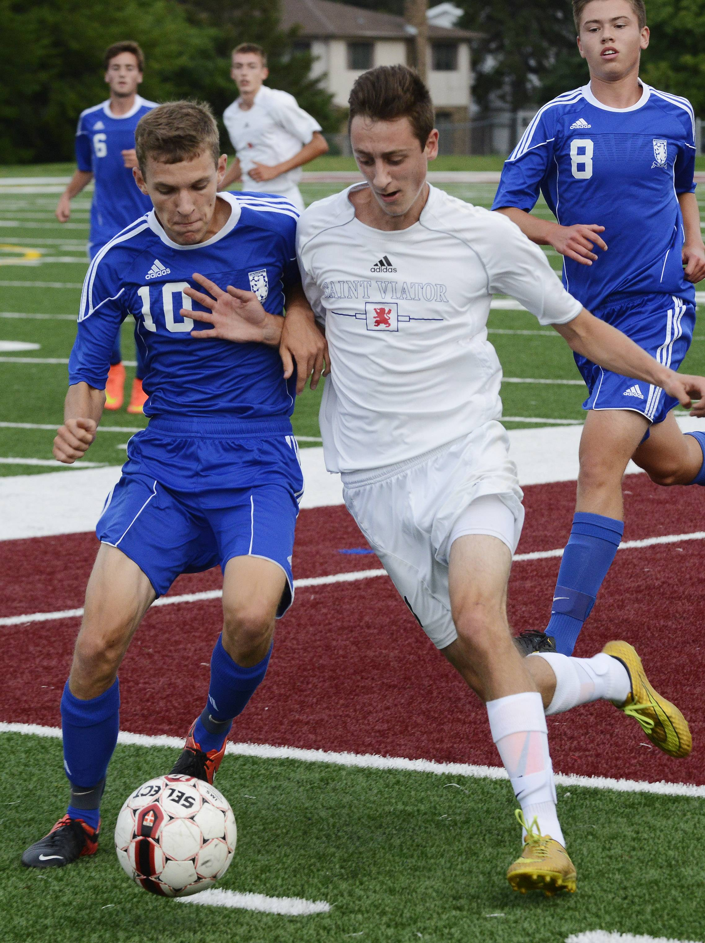 Lake Zurich's Jacob Karbowski, left, and St. Viator's Zach Gyurizca make contact as they pursue the ball during Wednesday's game in Arlington Heights.