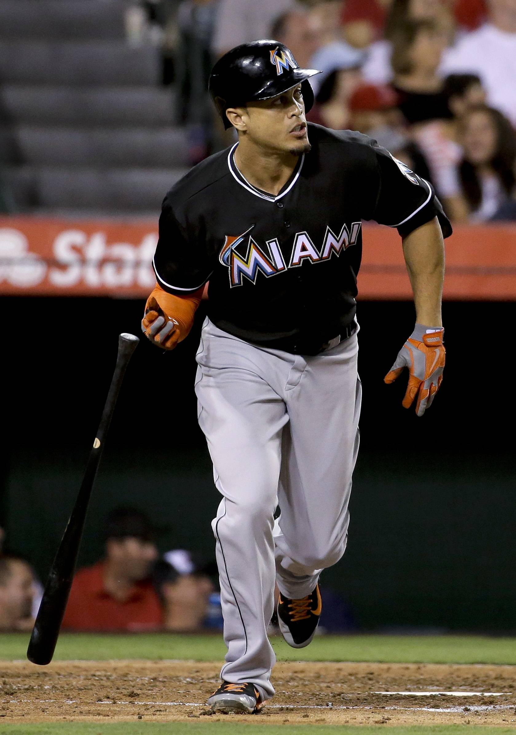 Wouldn't Marlins slugger Giancarlo Stanton, watching a 3-run homer sail out, look good in a young Cubs lineup?