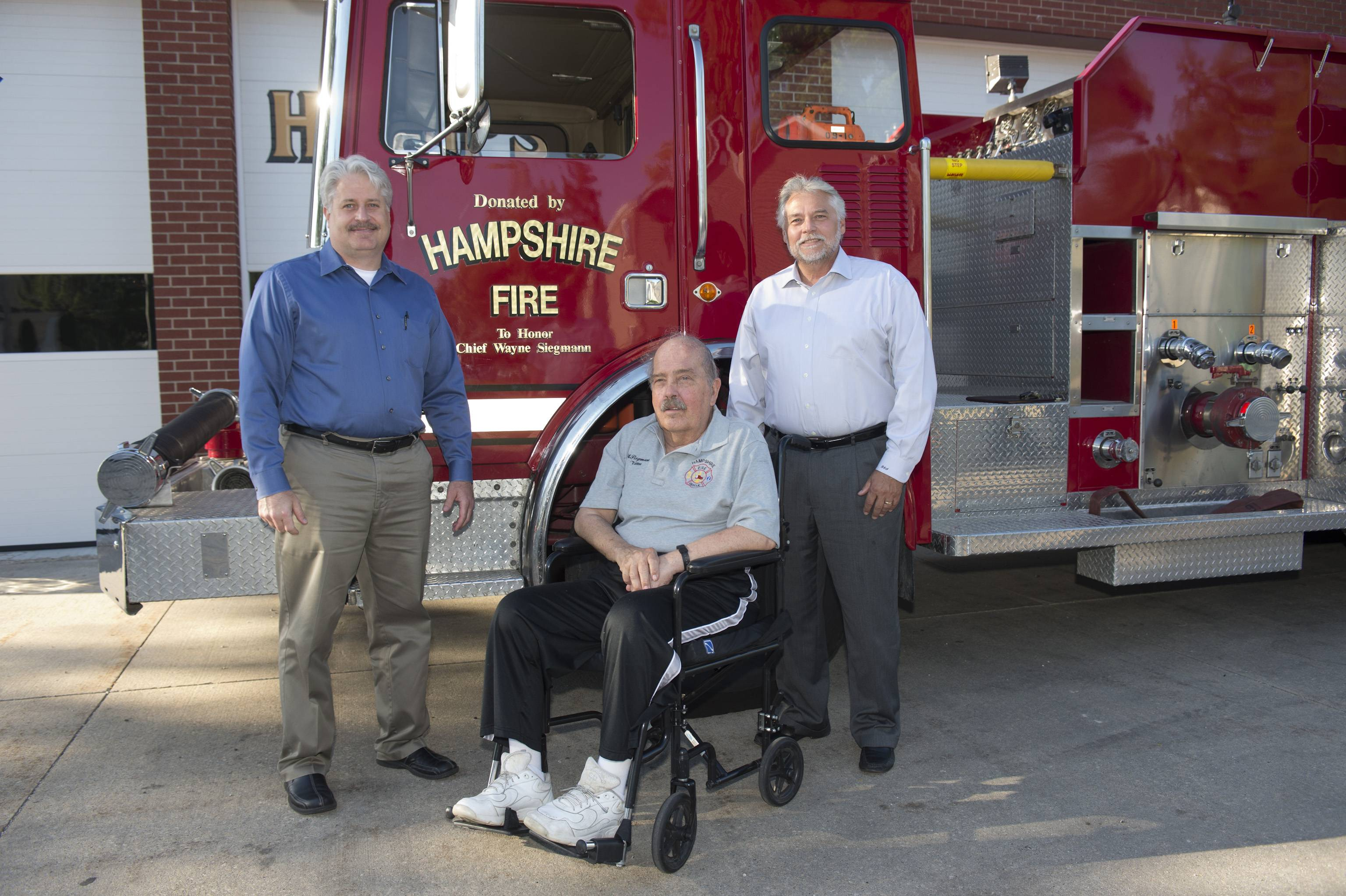 Elgin Community College recently received a donated fire truck. Pictured, from left, are Carl DeCarlo, ECC unit adjunct faculty and instructional coordinator for fire science and safety, retired Hampshire Fire Protection District Chief Wayne Siegmann, and Scott Adams, ECC associate dean of sustainability, safety and career tech.