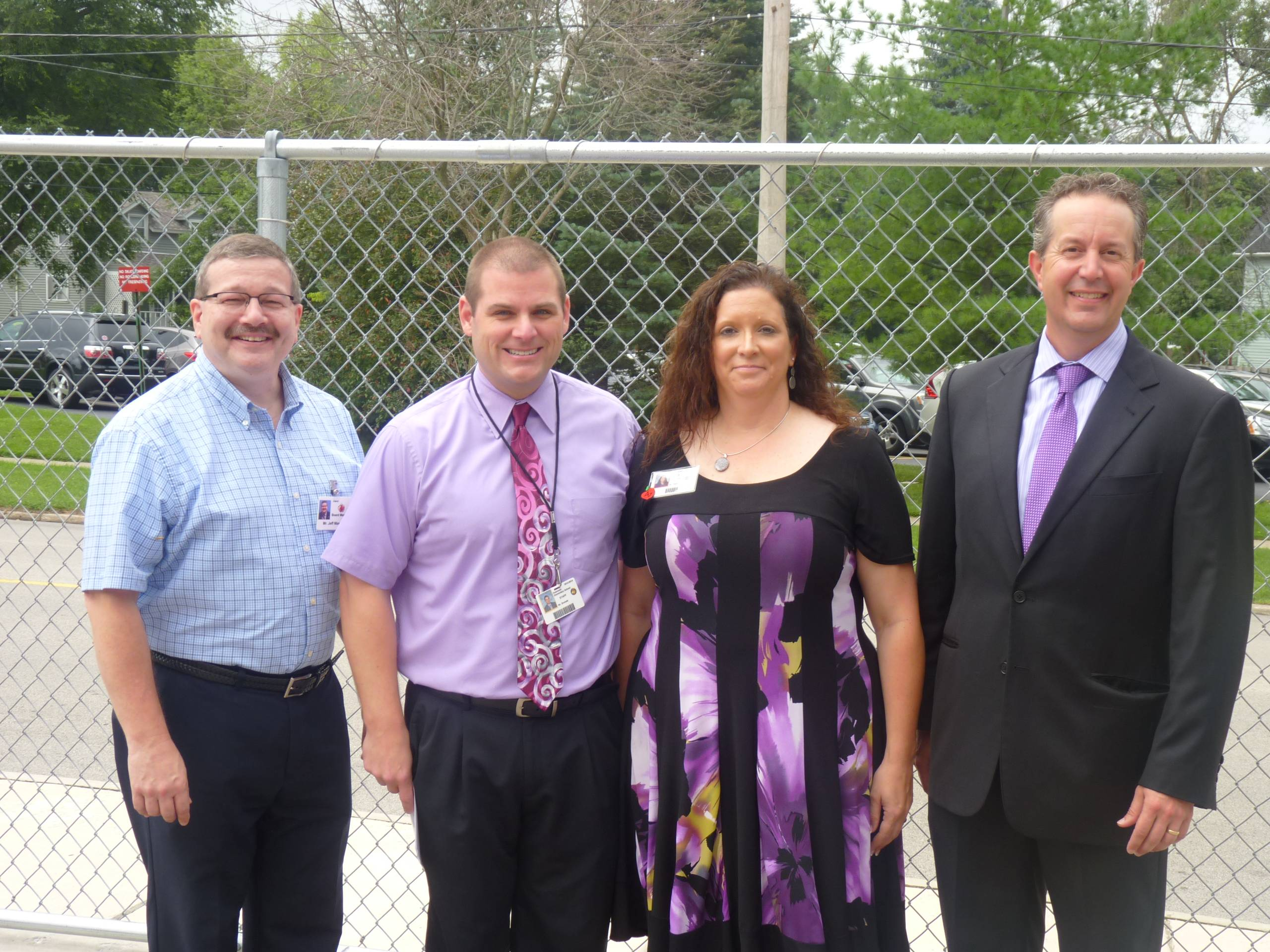 Crystal Lake Elementary District 47 board president Jeff Mason, assistant principal Guy Sromek, superintendent Kathy Hinz and Crystal Lake Mayor Aaron Shepley welcome students back to school at Husmann Elementary.