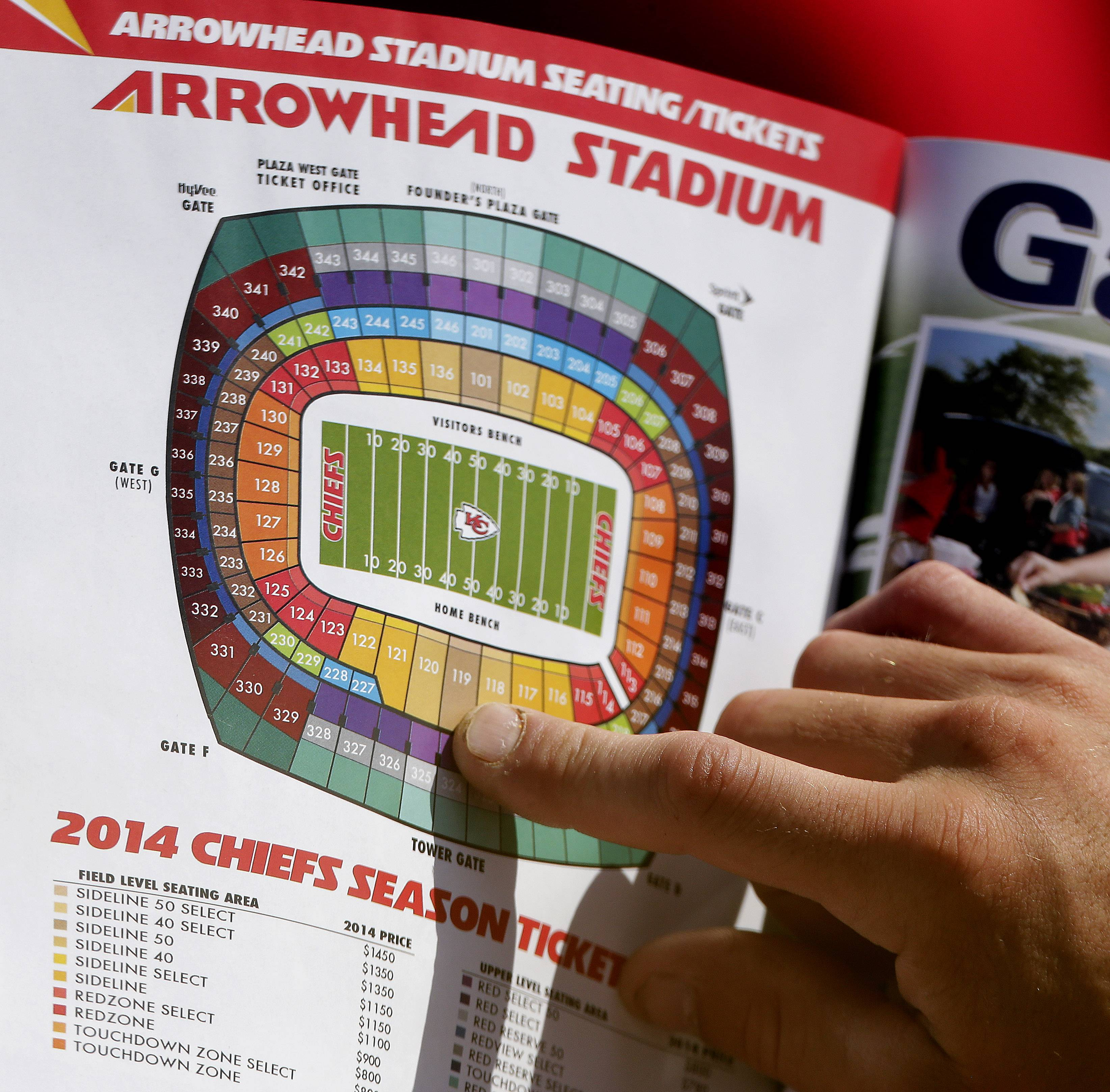 A fan looks at a season ticket seating map during NFL football practice at the Kansas City Chiefs' training camp in St. Joseph, Mo. By making fans feel as though they're part of the team and offering gifts and experiences exclusive to members, the Chiefs have managed to expand their season ticket sales at a time when many franchises are having a hard time filling their stadiums.