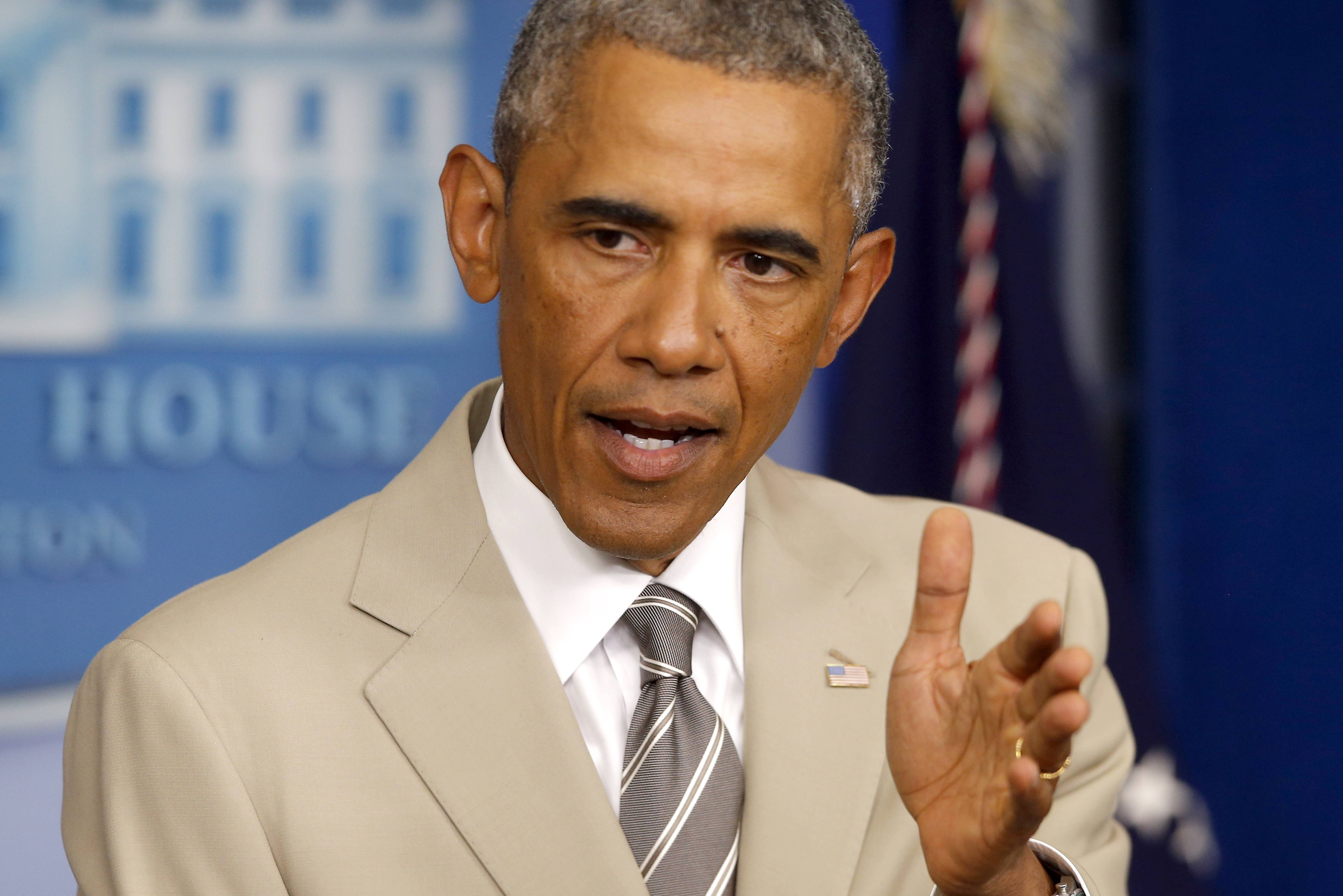 ASSOCIATED PRESS President Barack Obama addressed Syria, Ukraine, immigration and other topics Thursday at an appearance in the White House briefing room, but it was his choice of suits that first caught everyone's attention.