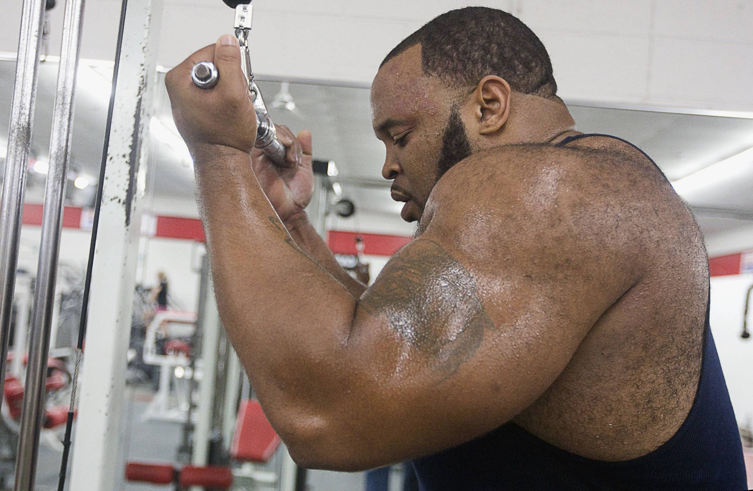 Chris Rice works on his triceps during a workout at Club Fitness in Decatur.