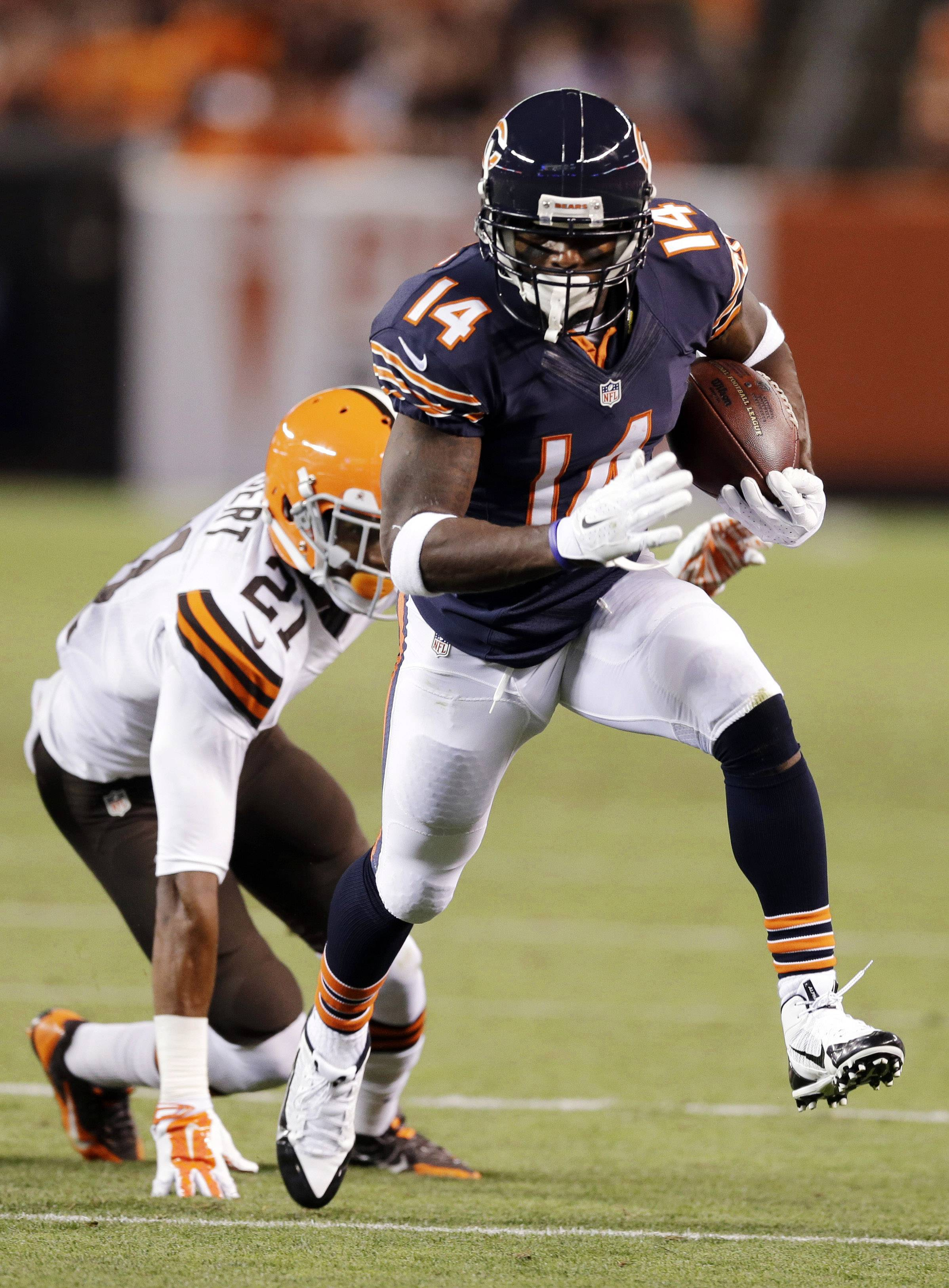 Bears wide receiver Santonio Holmes beats Cleveland Browns cornerback Justin Gilbert on a 32-yard touchdown reception in the second quarter of a preseason game in Cleveland.