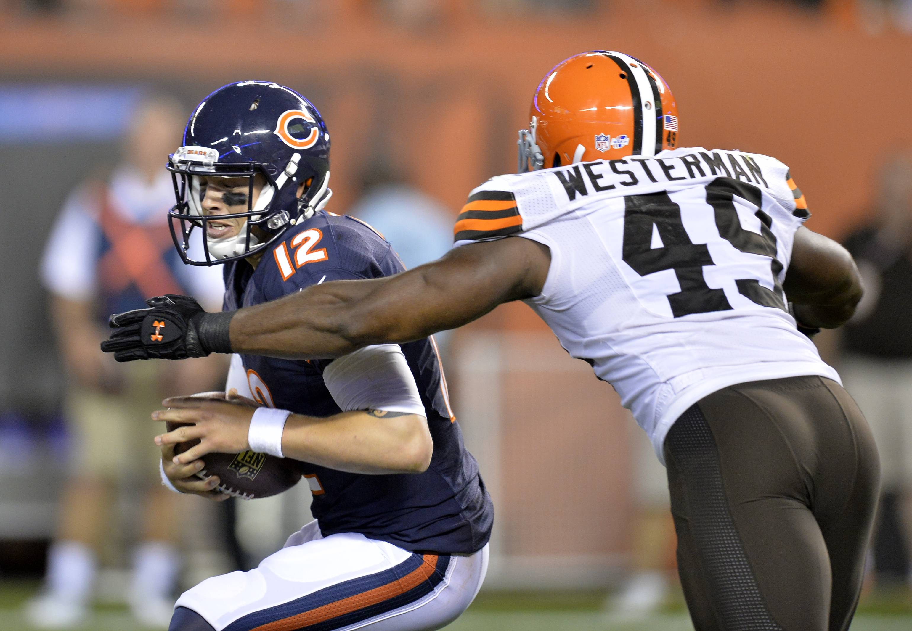Cleveland Browns linebacker Jamaal Westerman (49) sacks Chicago Bears quarterback David Fales (12) in the fourth quarter.