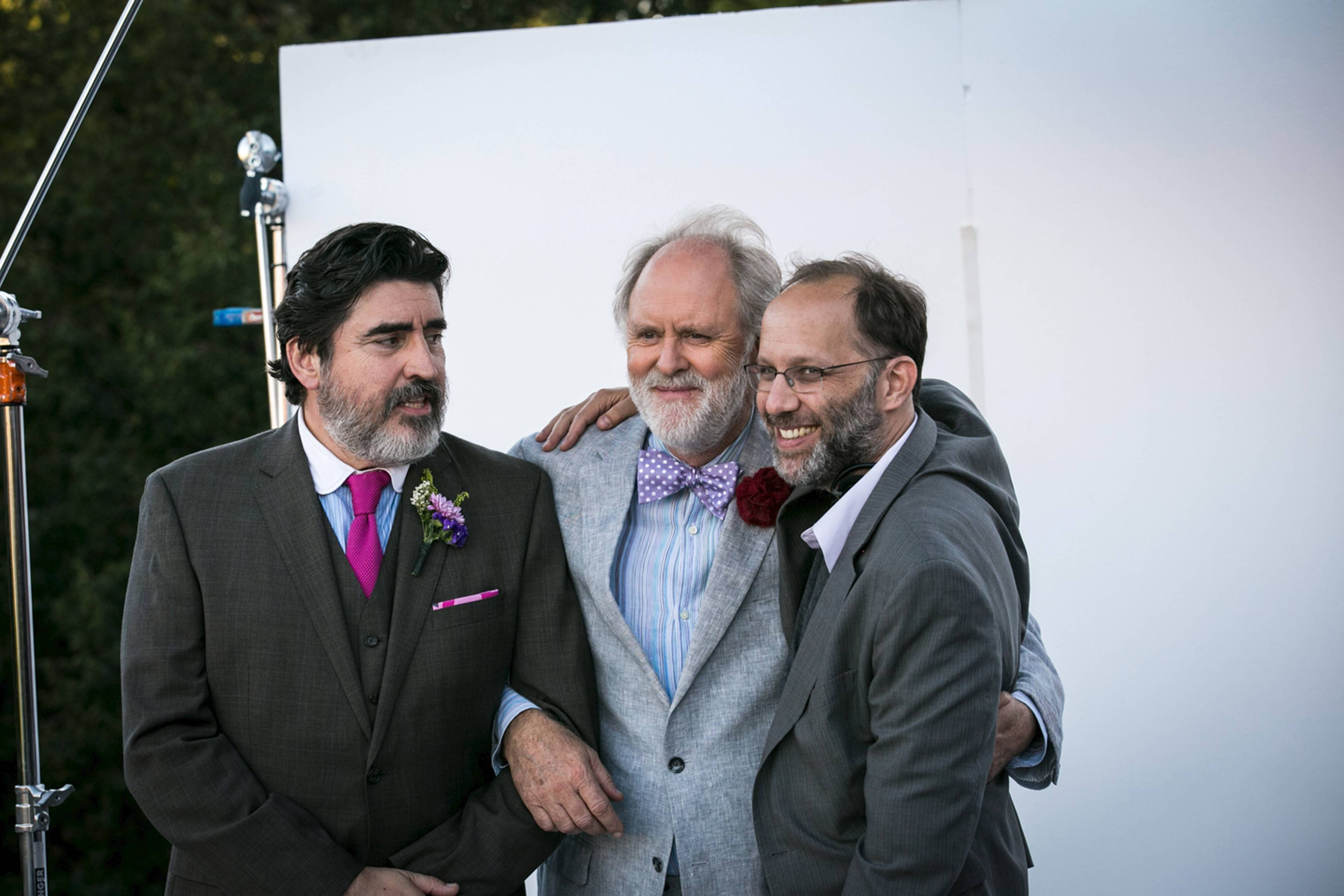 "Stars Alfred Molina, left, and John Lithgow pal around with director Ira Sachs, right, on the set of ""Love is Strange."""
