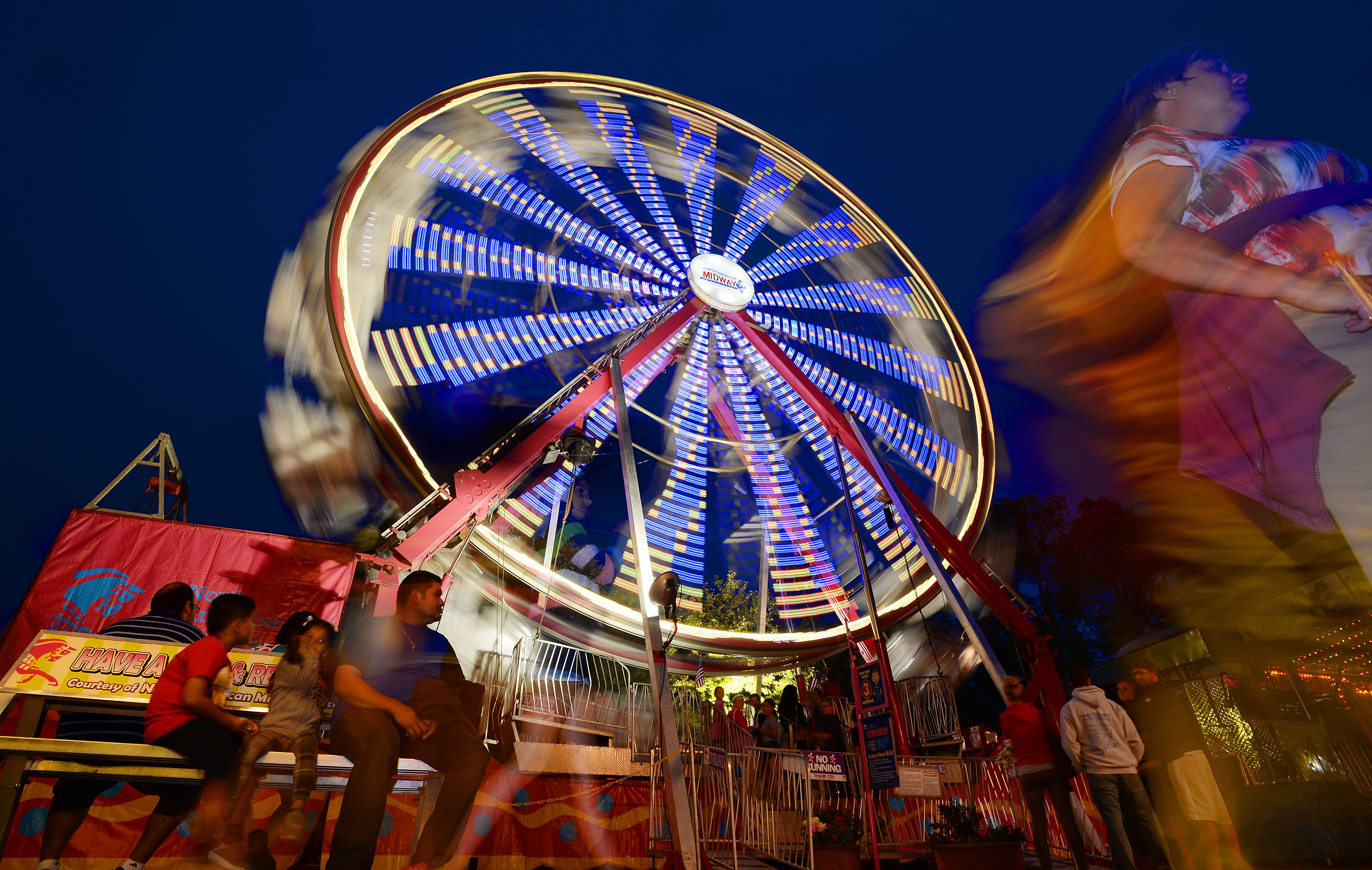 The first day of Buffalo Grove Days had the Ferris wheel spinning, thrilling young and old as a light rain started to fall Thursday.