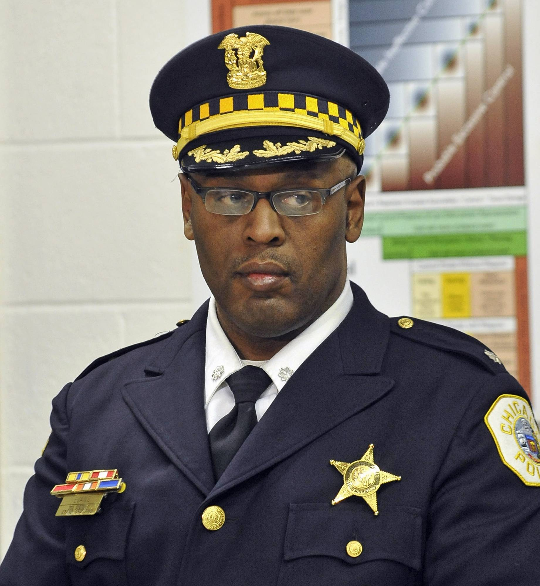 Chicago police Cmdr. Glenn Evans has been stripped of his police powers after being charged with aggravated battery and official misconduct.