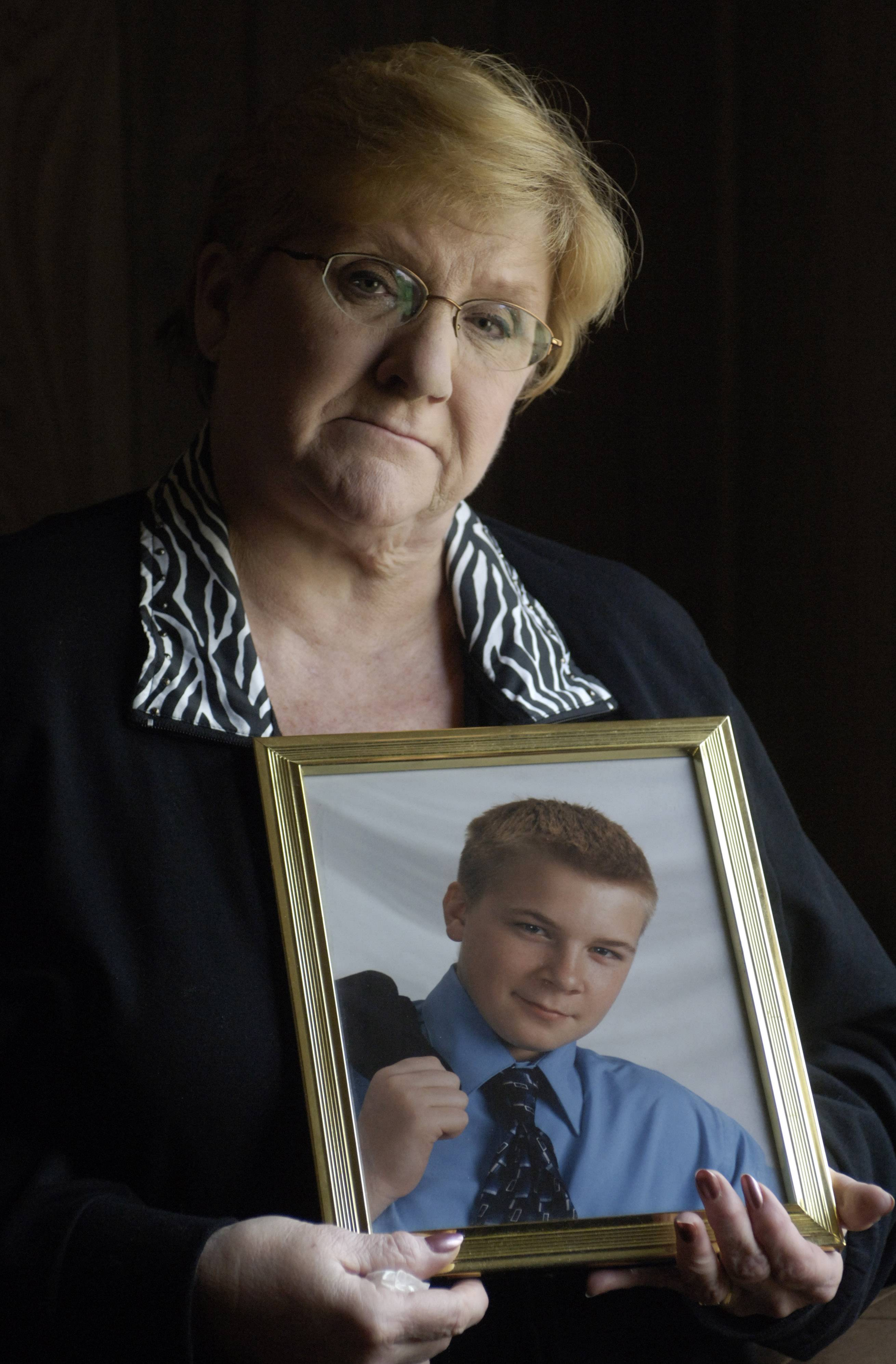 Nancy Koschman holds a photo of her son, David, who died in 2004 after a fight outside a Chicago bar.