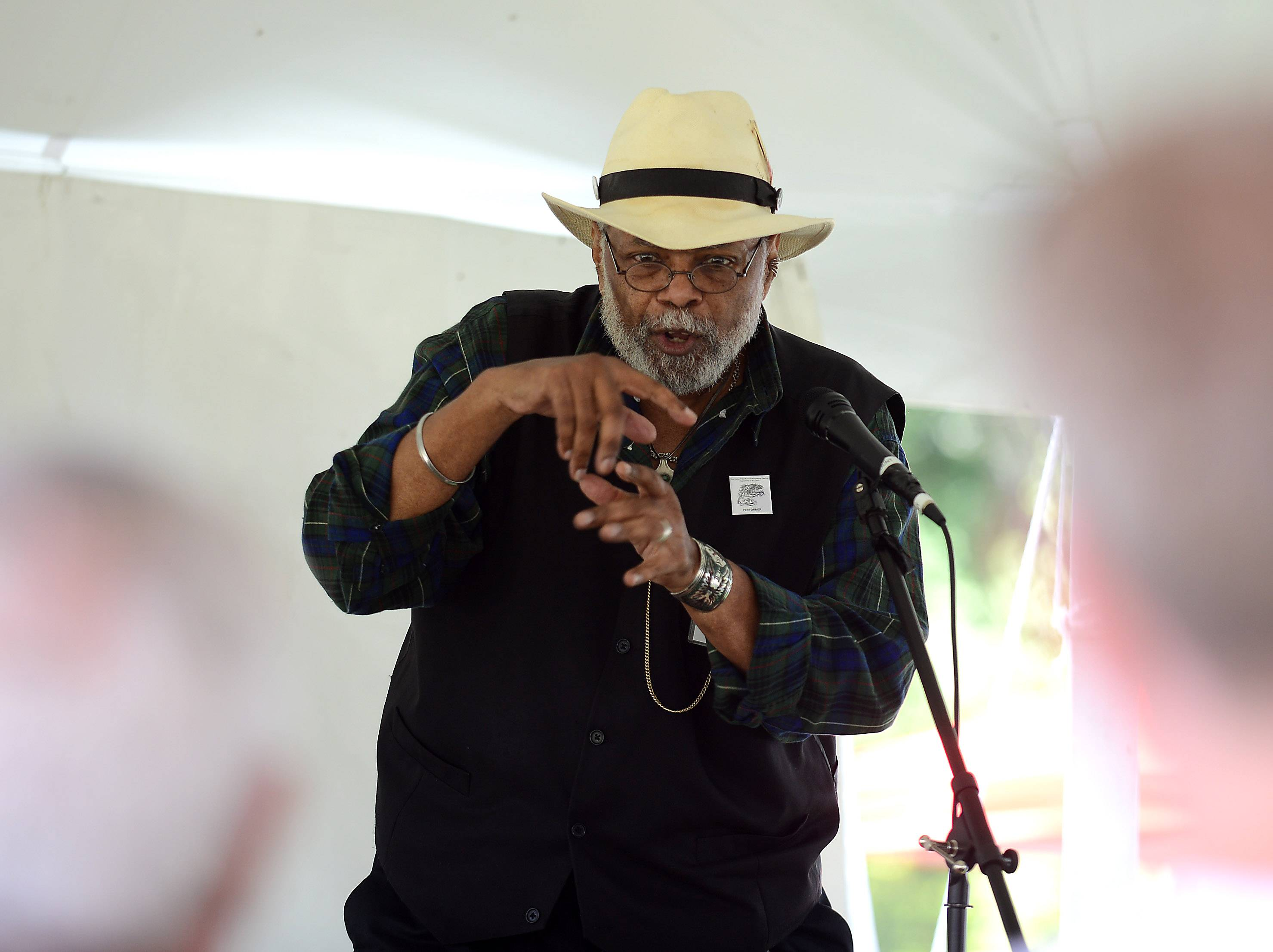 Sparky Rucker of Maryville, Tennessee, weaves a tale about a man who killed the devil for the crowd at the storytelling tent during the 37th annual Fox Valley Folk Music and Storytelling Festival at Island Park in Geneva.
