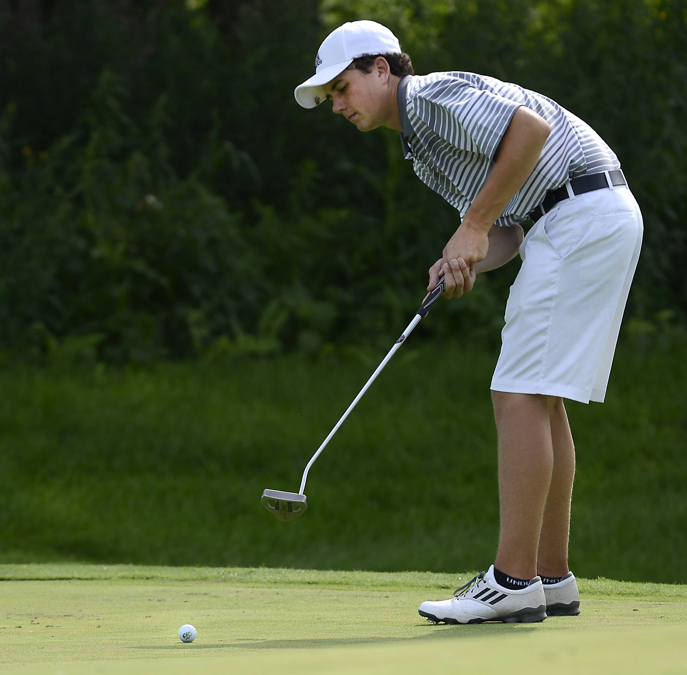 Kaneland's Jeremy Faletto putts on #9 Thursday at the Geneva boys golf invitational at Mill Creek Golf Club.