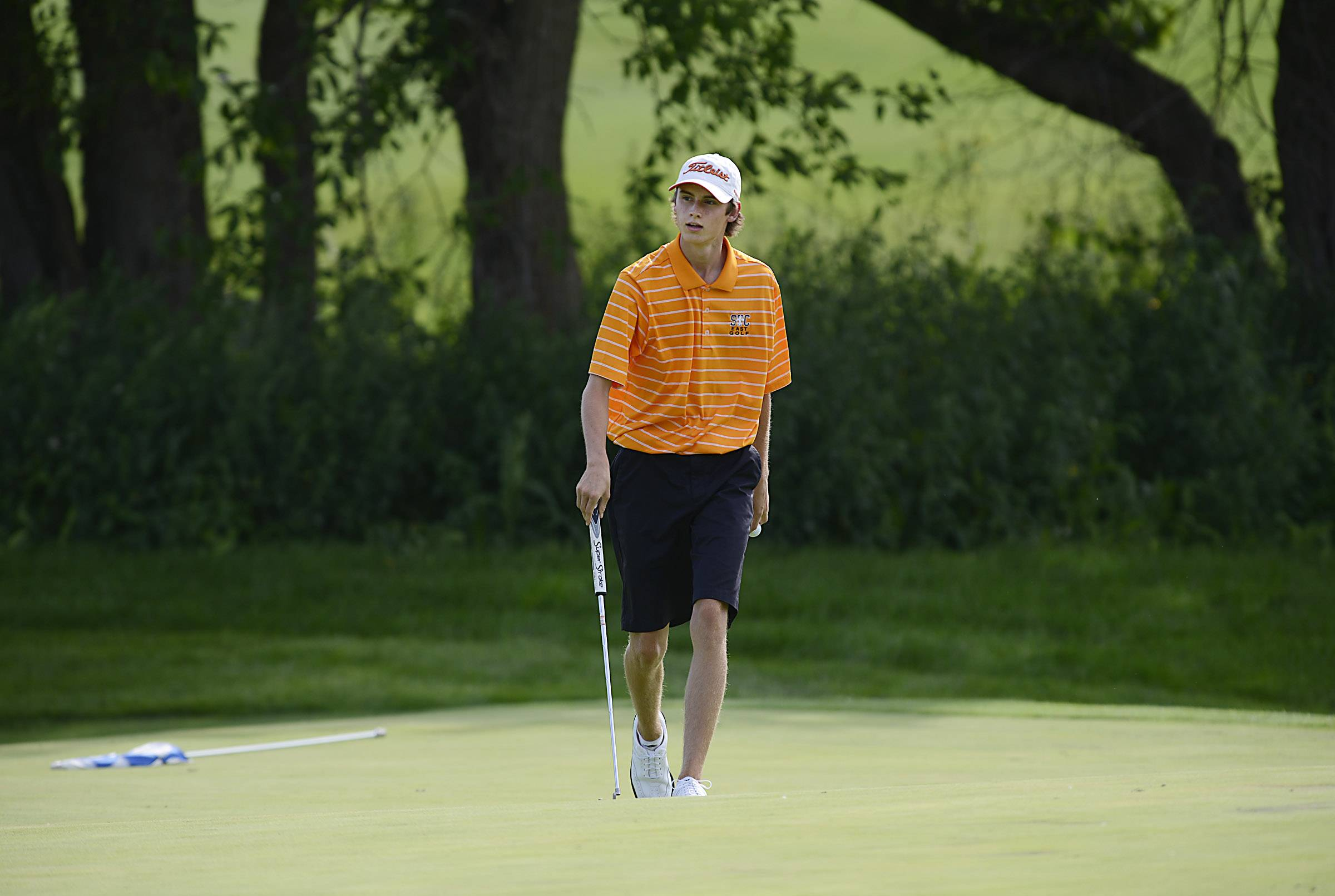 St. Charles East's Gary King won the individual title and his Saints squad claimed the team championship Thursday at the Geneva boys golf invitational at Mill Creek Golf Club.