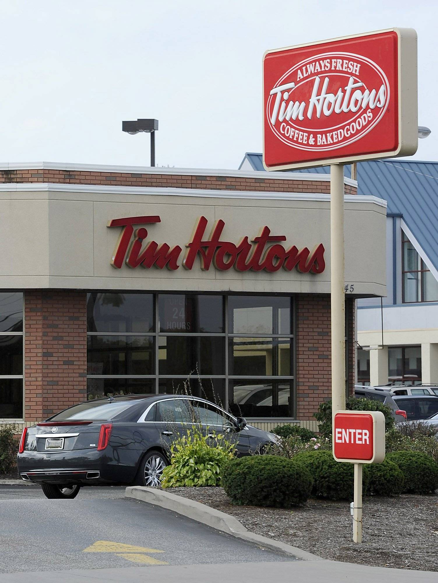 A Tim Hortons restaurant on W. 26th Street in Millcreek Township, Pa. Burger King struck an $11 billion deal to buy Tim Hortons that would create the world's third largest fast-food company and could make the Canadian coffee-and-doughnut chain more of a household name around the world.