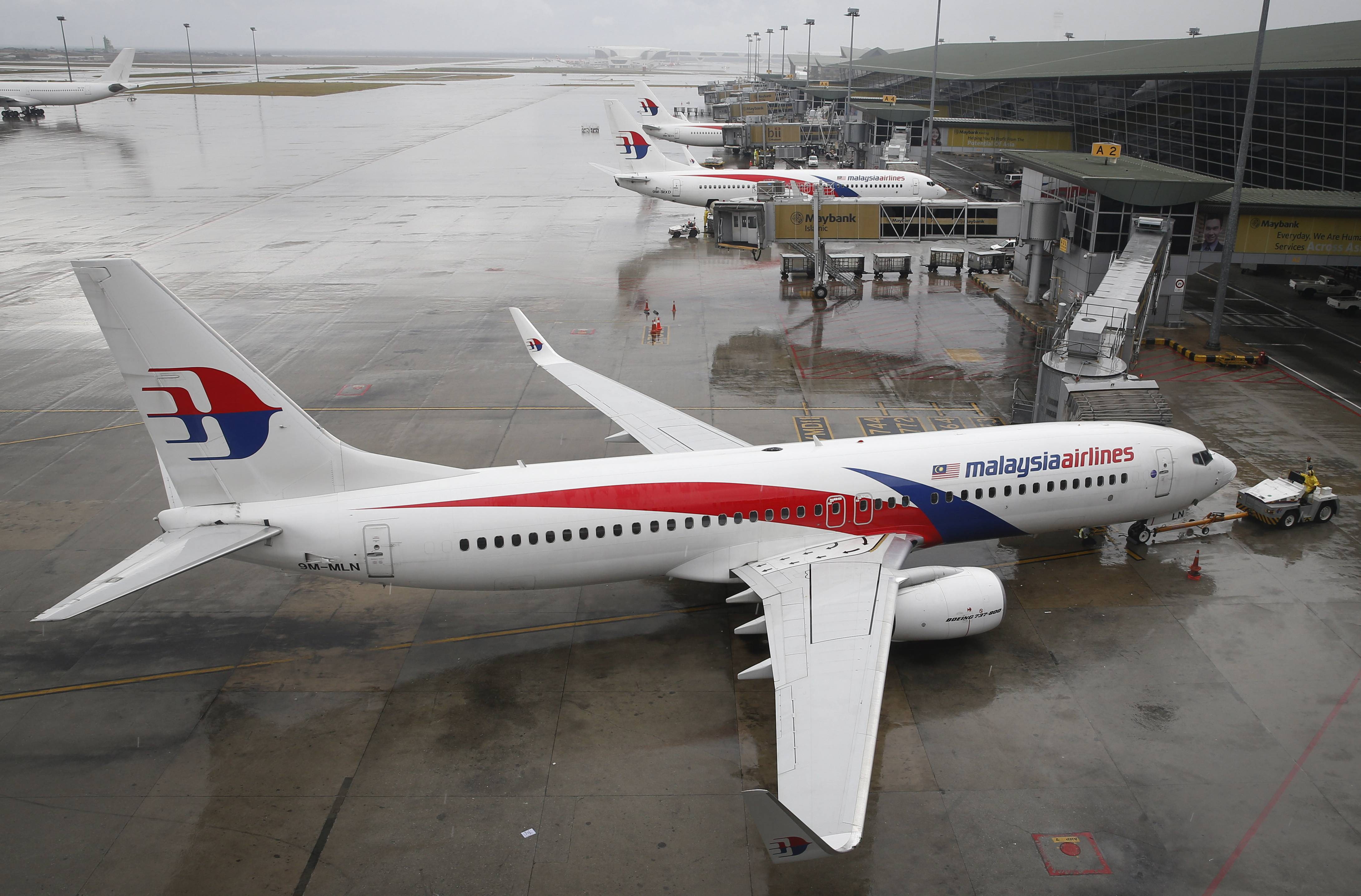 A Malaysia Airlines Boeing 737-800 plane sits on tarmac at Kuala Lumpur International Airport in Sepang, Malaysia.