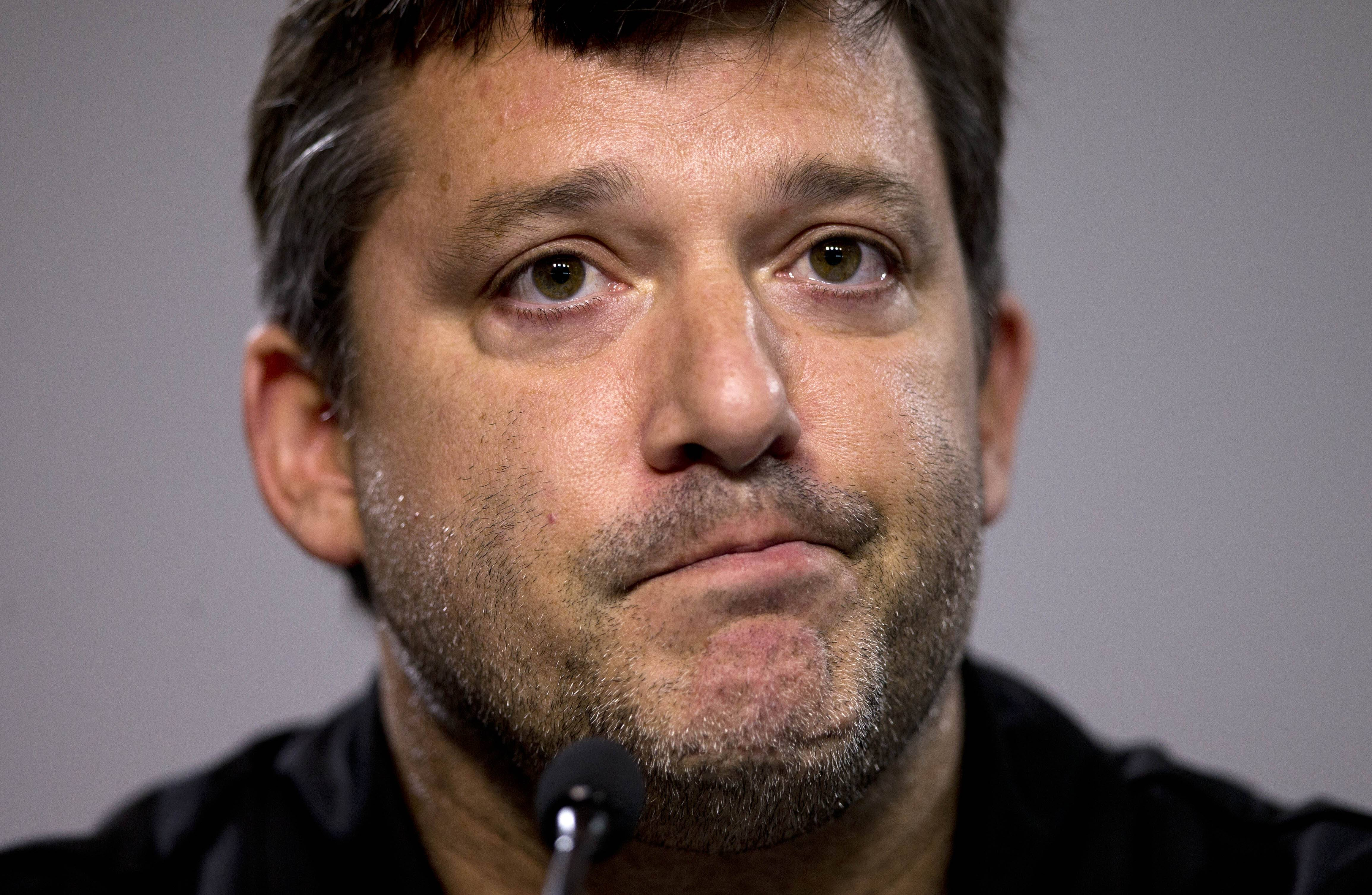 "NASCAR auto racing driver Tony Stewart reads a statement during a news conference at Atlanta Motor Speedway in Hampton, Ga., on Friday. Stewart says the death of Kevin Ward Jr. will ""affect my life forever"" as he returned to the track for the first time since his car struck and killed the fellow driver during a sprint-car race in New York. (AP Photo/John Bazemore)"