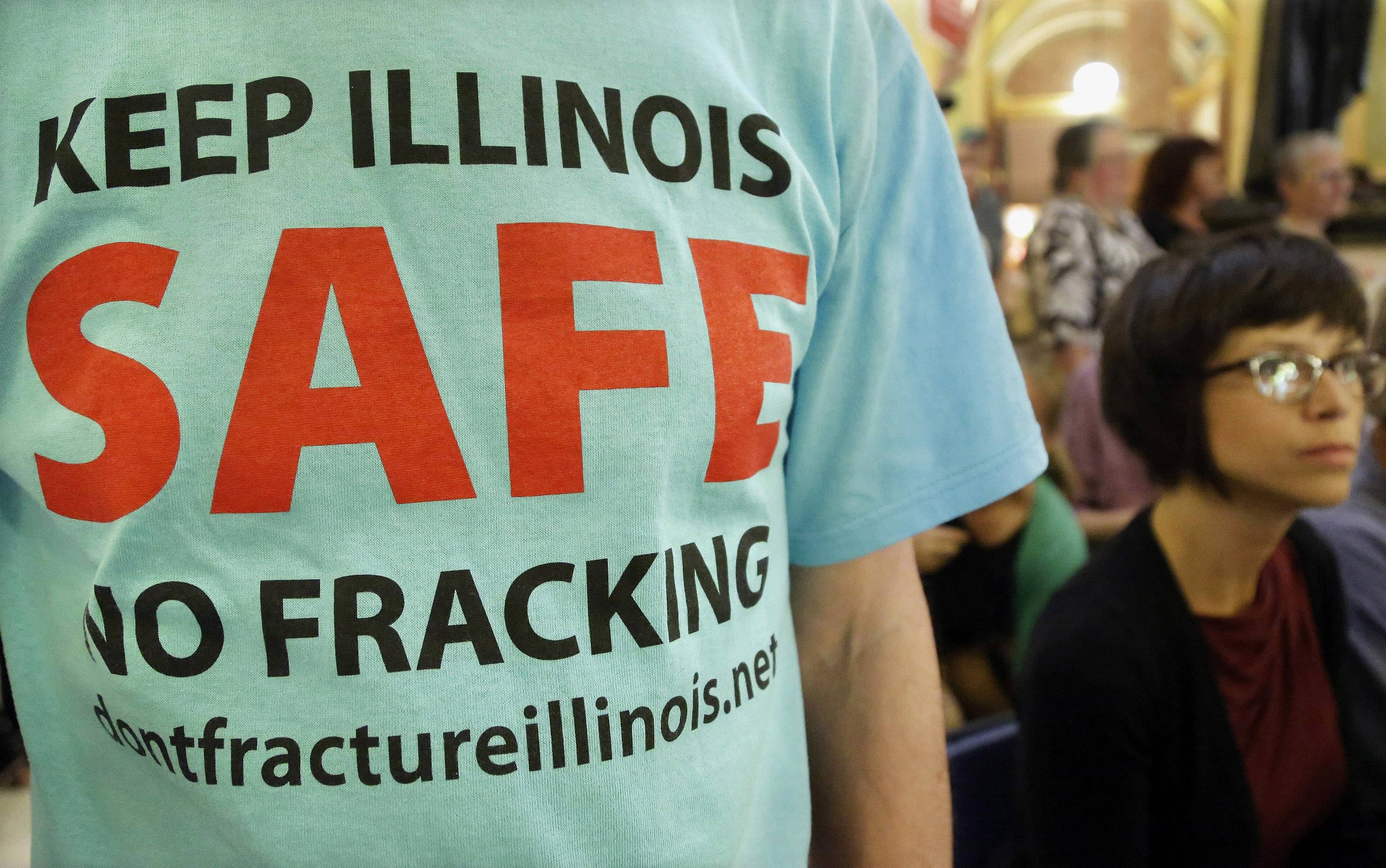 "A protester attends a rally after a House committee hearing on ""fracking"" legislation at the state Capitol in Springfield. The Illinois Department of Natural Resources released a long-awaited plan to regulate high-volume oil and gas drilling that supporters hope could bring an economic boost to southern Illinois."