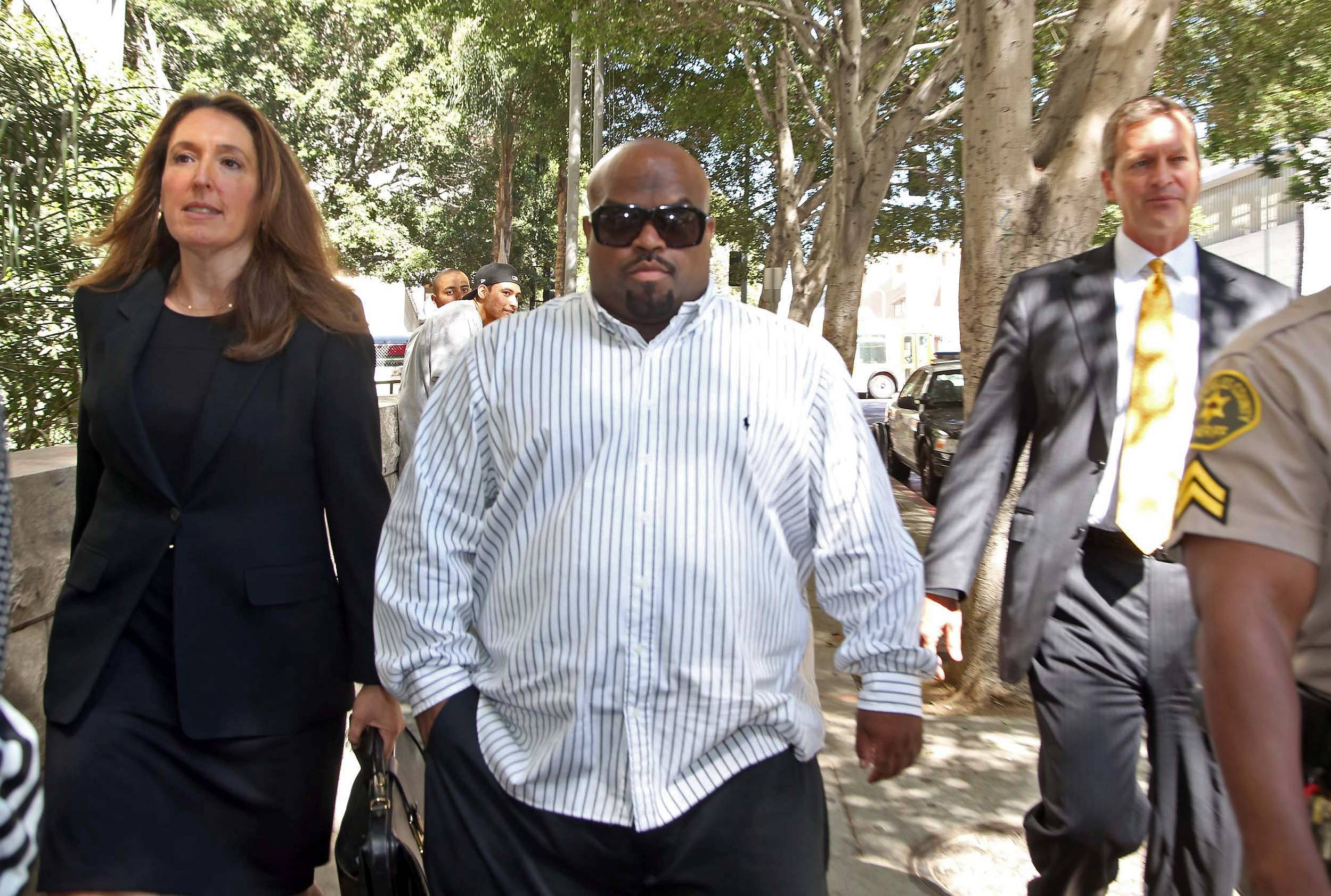 Cee Lo Green leaves Los Angeles Superior Court after a hearing Friday. Green pleaded no contest to giving a woman ecstasy during a 2012 dinner in Los Angeles. He was sentenced to three years of probation and 360 hours of community service.