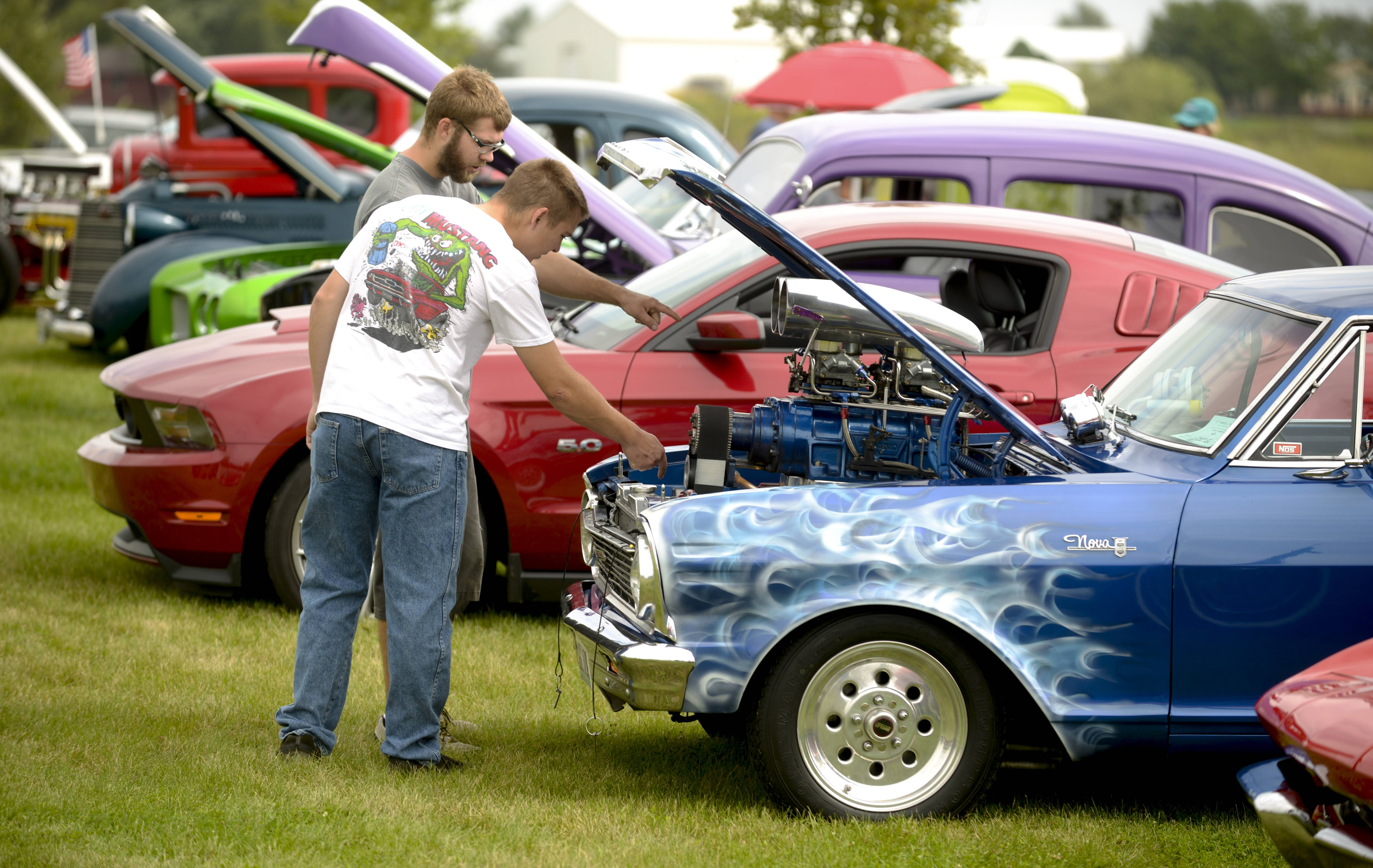 Hayden Senese and Evan Olson of Sugar Grove check out a souped-up 1965 Chevy Nova at Kane County Sheriff Pat Perez's Eighth Annual Car and Motorcycle Show at the Martin family farm in Elburn.