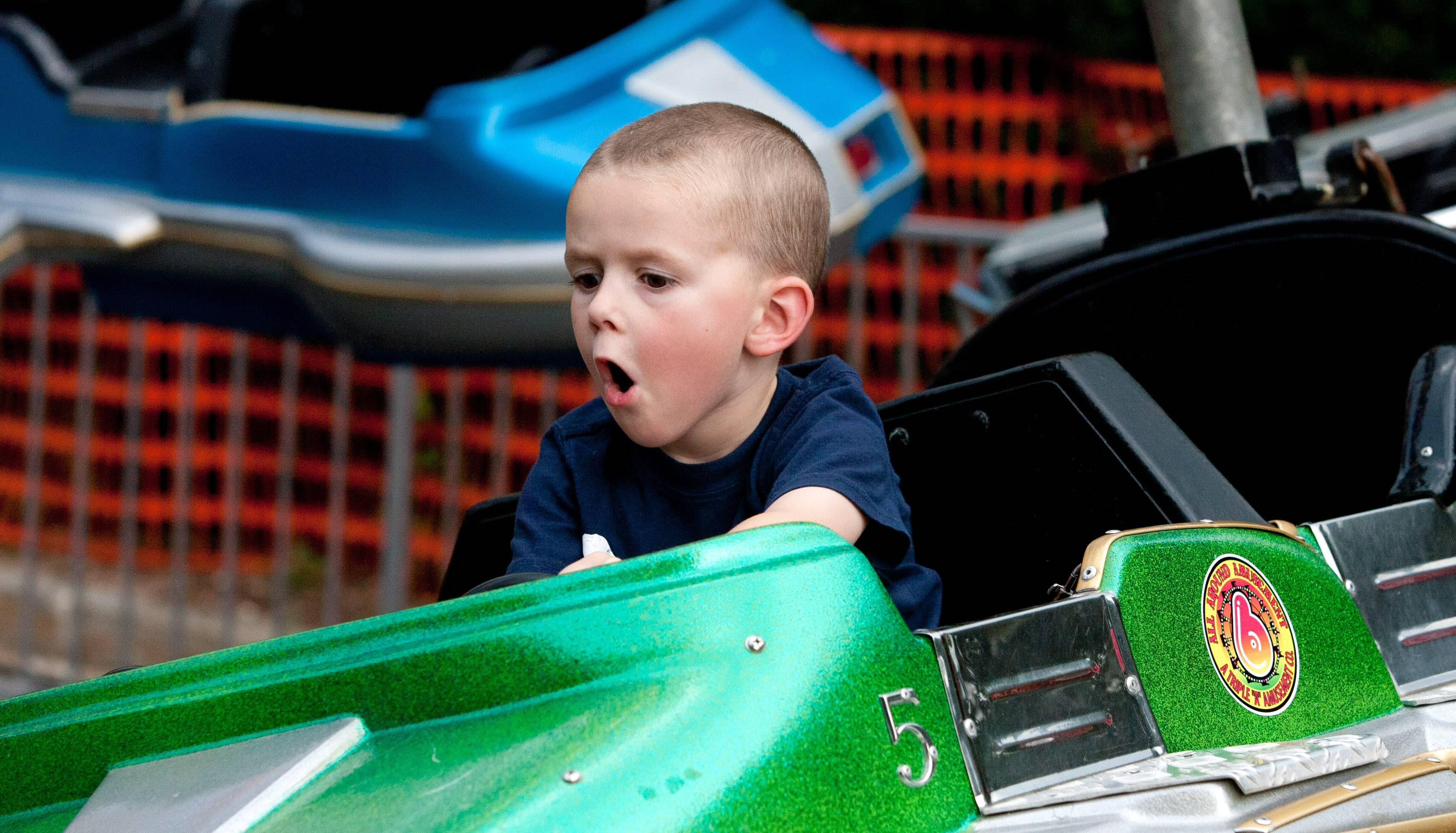 Daniel White/dwhite@dailyherald.comJack Maloney, 4, of Naperville enjoys his carnival ride during the opening day of the Last Fling celebration in Naperville.