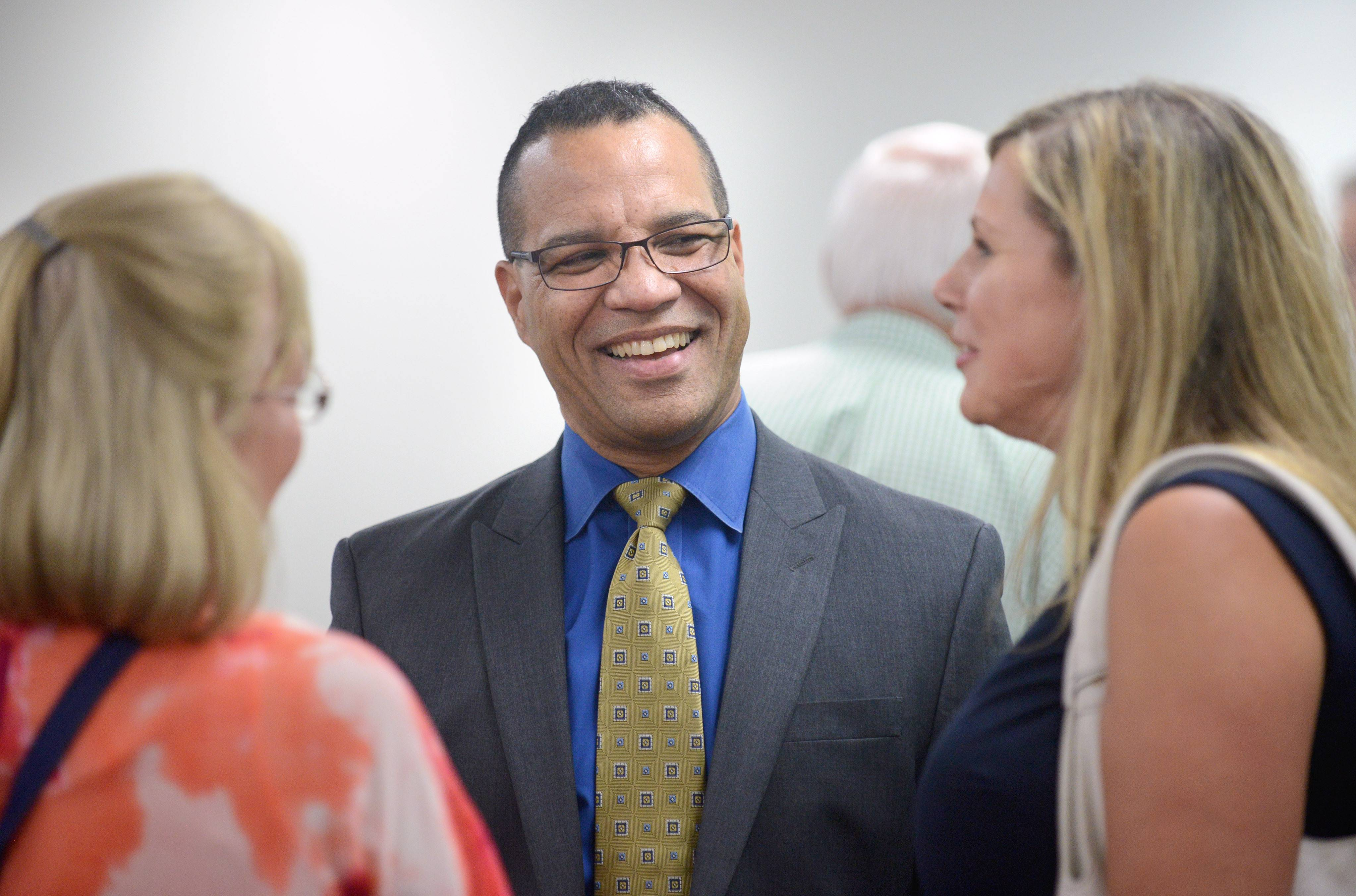 Elgin Area School District U-46 Superintendent Jose Torres talks with Sandy Christenson, left, and Anna Pasternak, of the records administration office, at his farewell reception.
