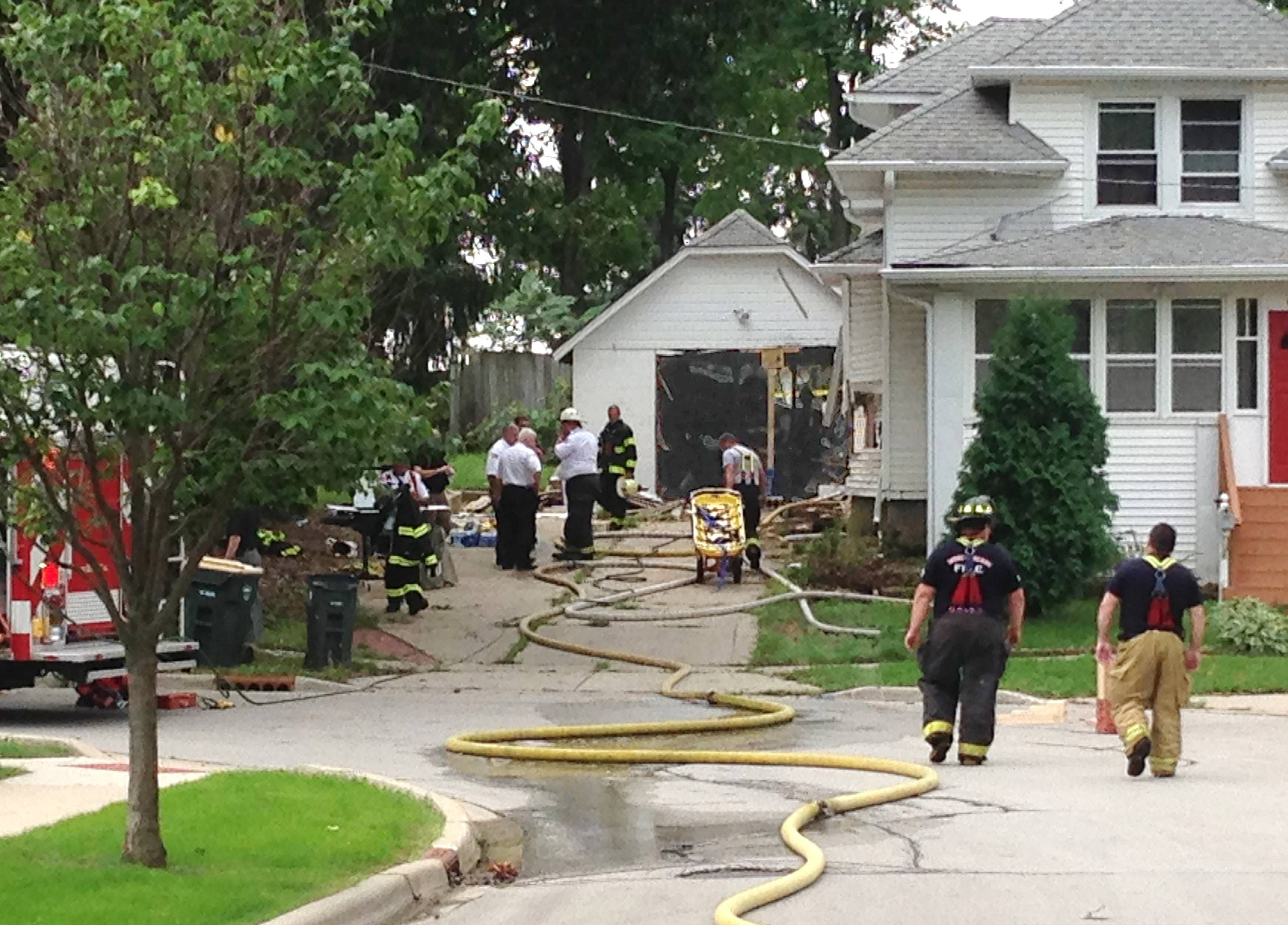 A large number of emergency personnel responded to the 400 block of Colford Avenue in West Chicago Friday morning after a car struck a house and garage. The driver was taken to an area hospital but no other injuries were reported.