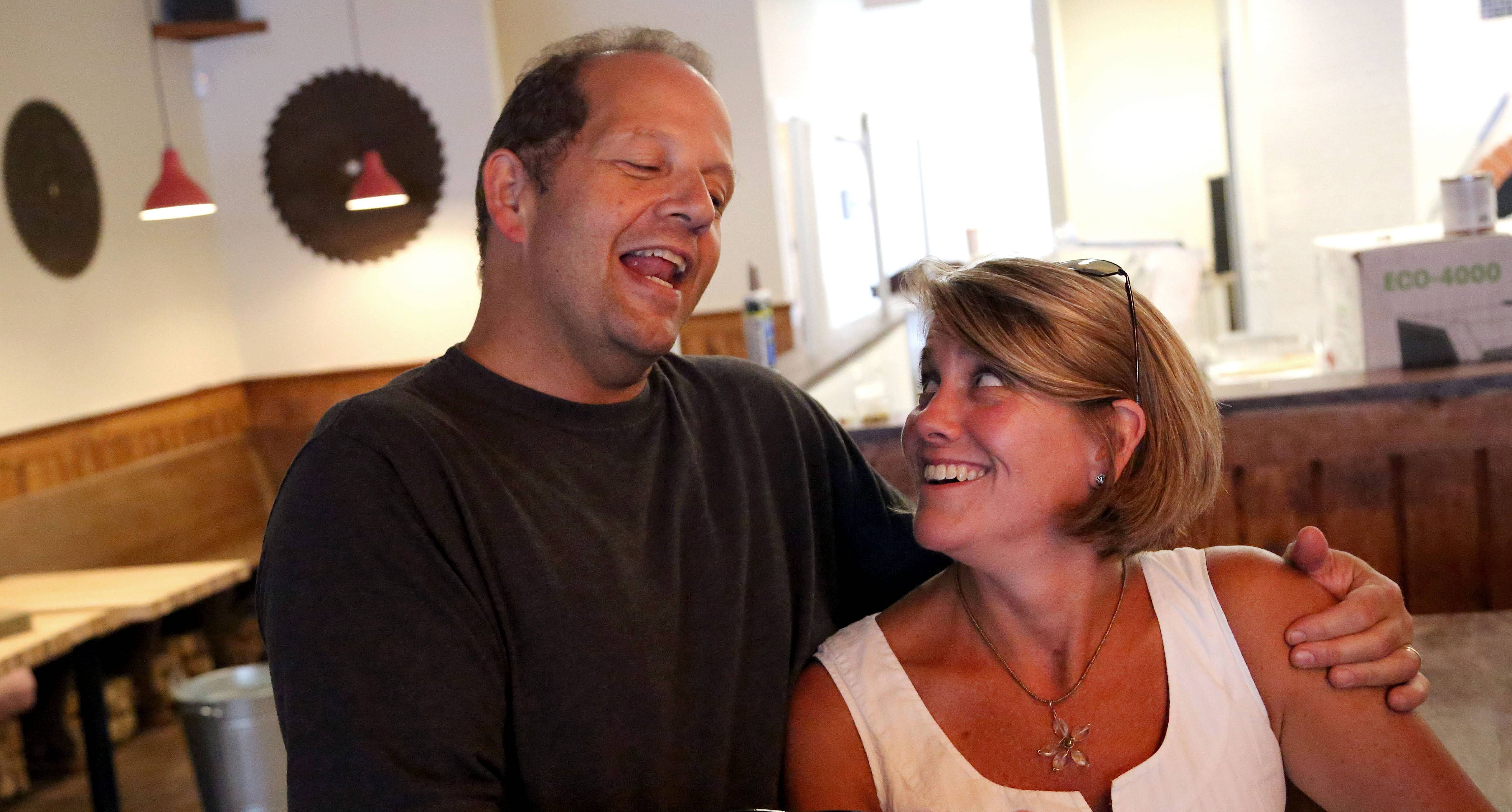 John Durning sings to his wife, Susie, a common occurrence at their Pizzeria DeVille in Libertyville.