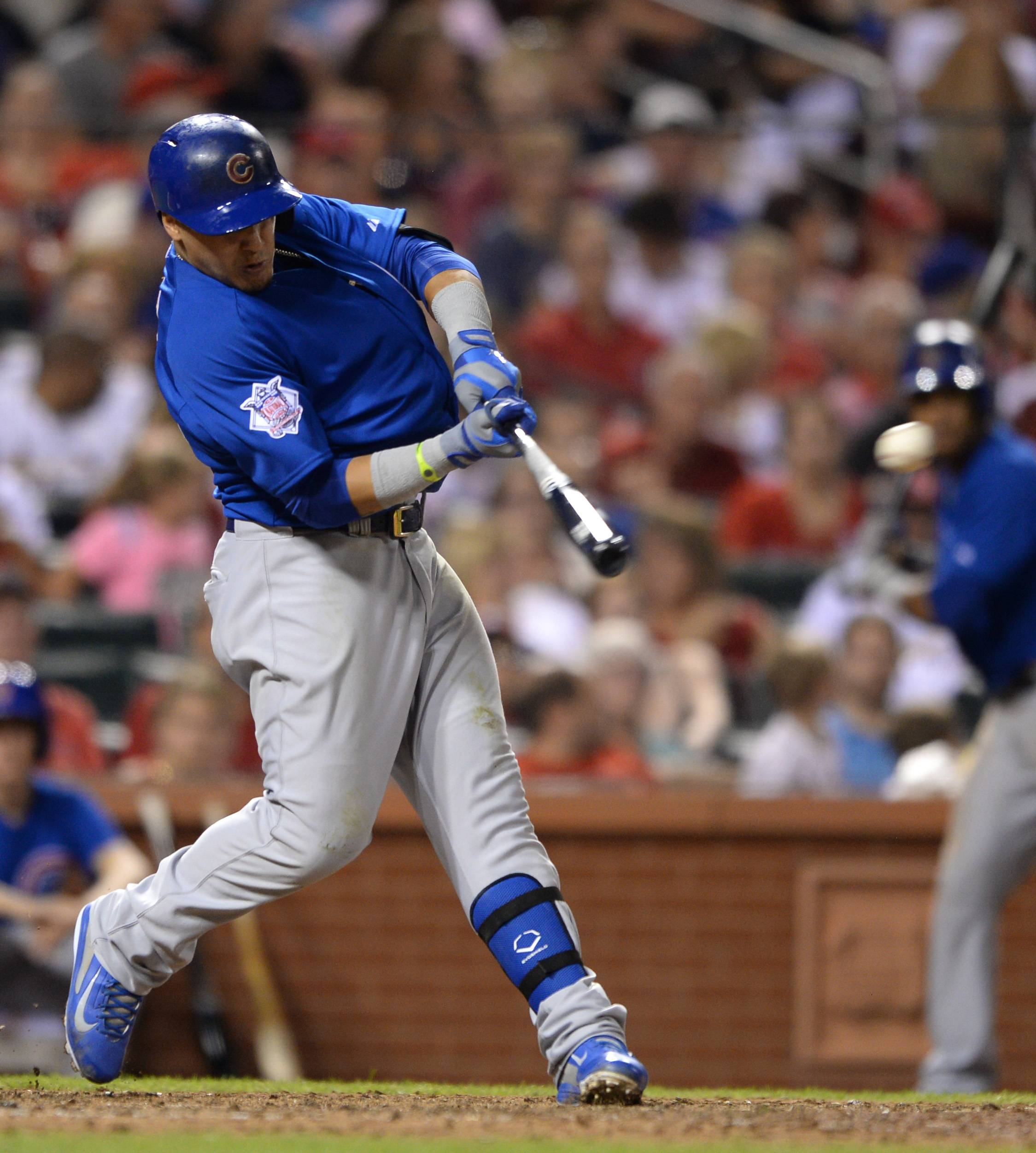 Javier Baez had a tiebreaking, two-run double in the eighth inning off All-Star reliever Pat Neshek as the Cubs beat the St. Louis Cardinals 7-2 on Friday night.