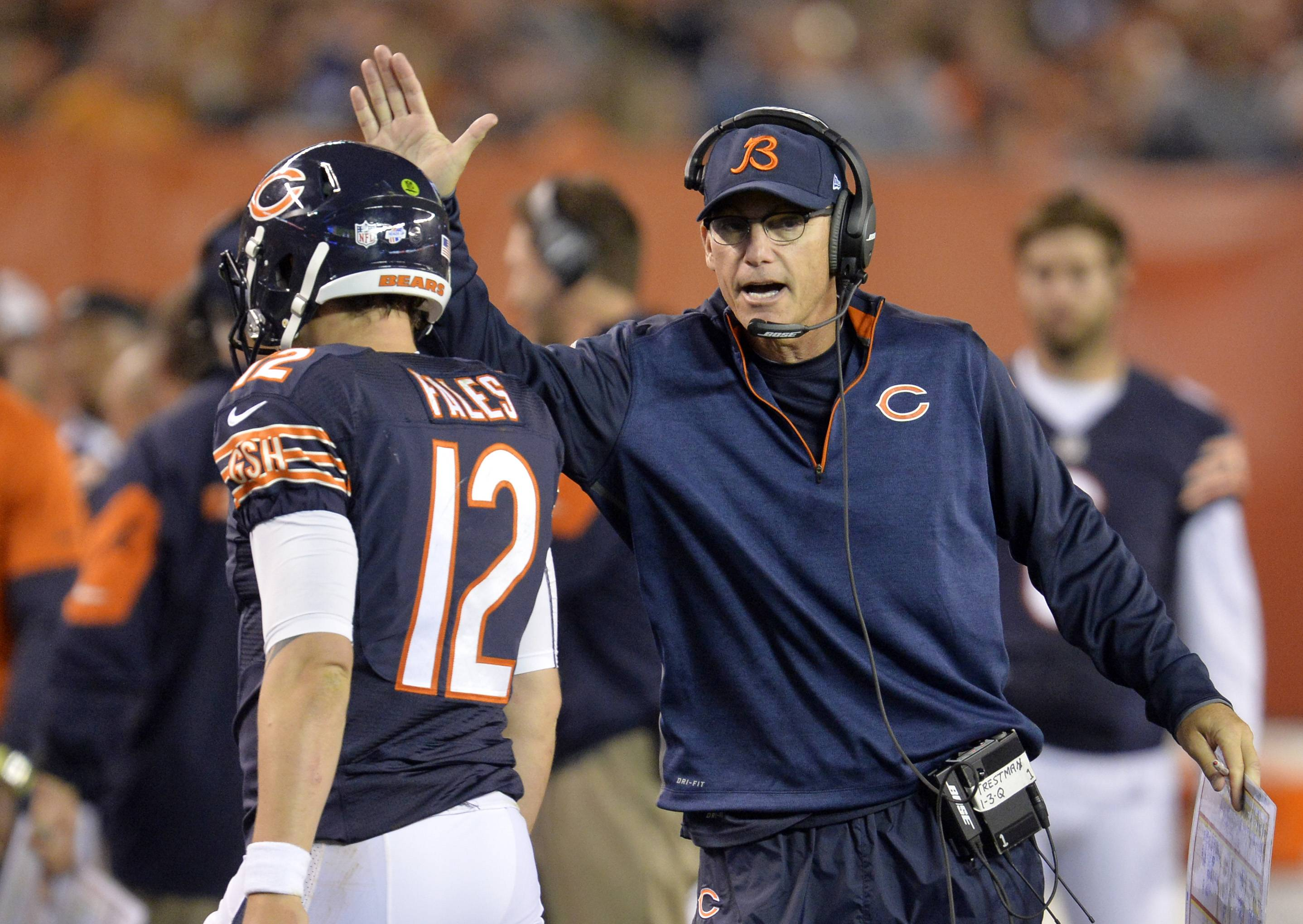 Chicago Bears head coach Marc Trestman congratulates quarterback David Fales (12) after a 32-yard touchdown pass against the Cleveland Browns in the second quarter of a preseason NFL football game Thursday, Aug. 28, 2014, in Cleveland.