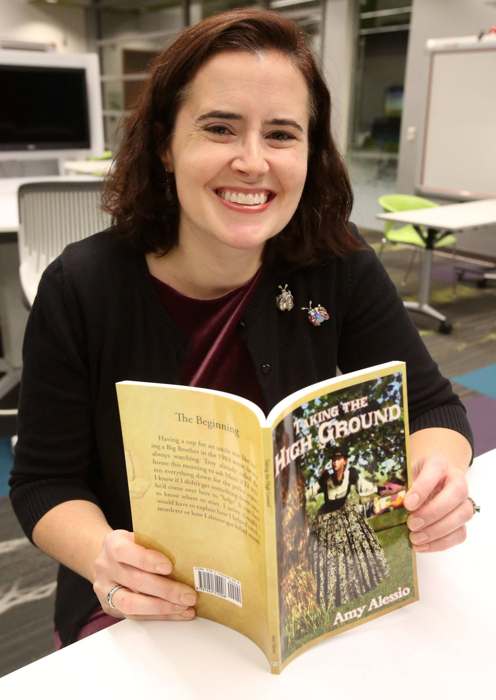 "Amy Alessio, shown with her book, ""Taking the High Ground,"" will speak at the ""Catch a Bunch of Authors Fair"" on Saturday, Sept. 6."