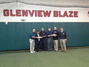 Roy and Georgette Frank accept a check from the Glenview Blaze Baseball Association.