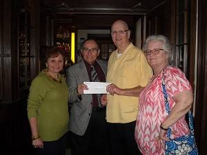 Roy and Georgette Frank present a check to Medal of Honor Recipient Al Lynch. Al and Susan Lynch administer the Allen J. Lynch Medal of Honor Veterans Foundation.