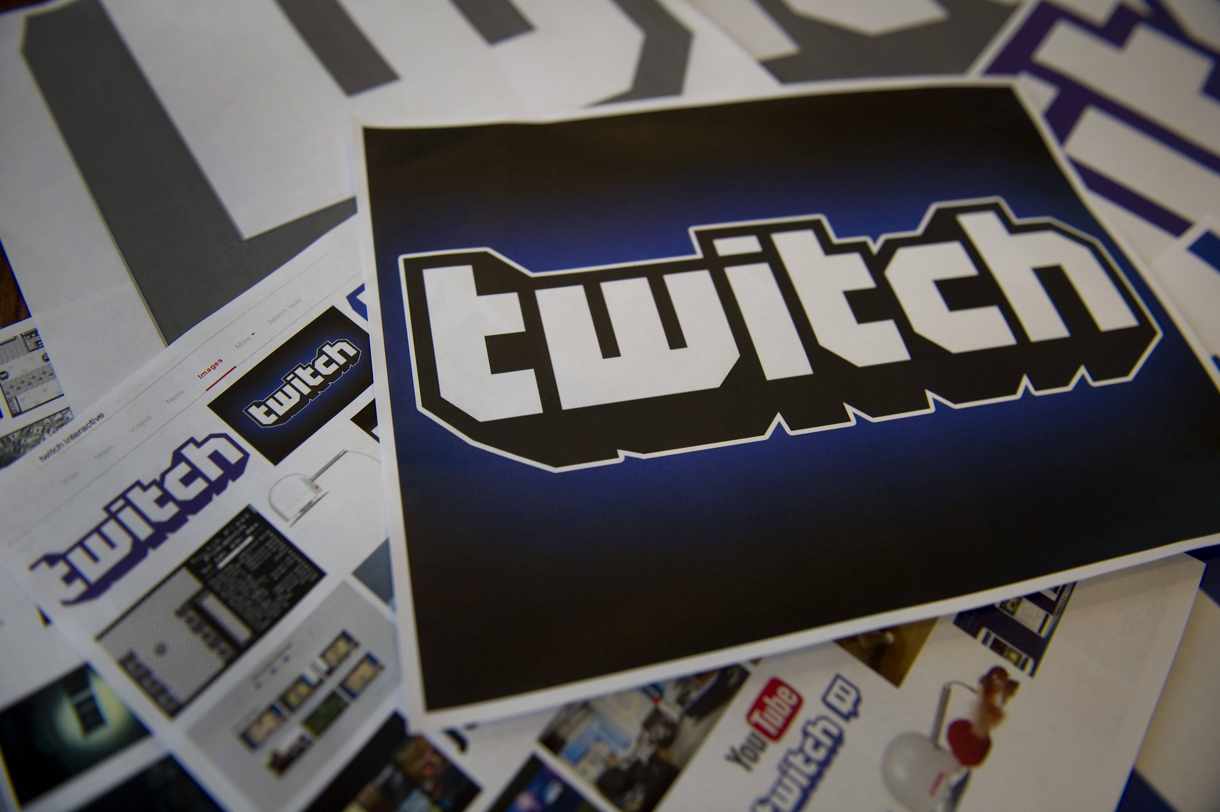 The Twitch Interactive Inc. logo is arranged for a photograph in San Francisco, California, U.S., on Monday, Aug. 25, 2014. Amazon.com Inc. is buying video service Twitch Interactive Inc. for more than $1 billion in its biggest acquisition ever, adding an online gathering place for video gamers, people with knowledge of the plans said. Photographer: David Paul Morris/Bloomberg