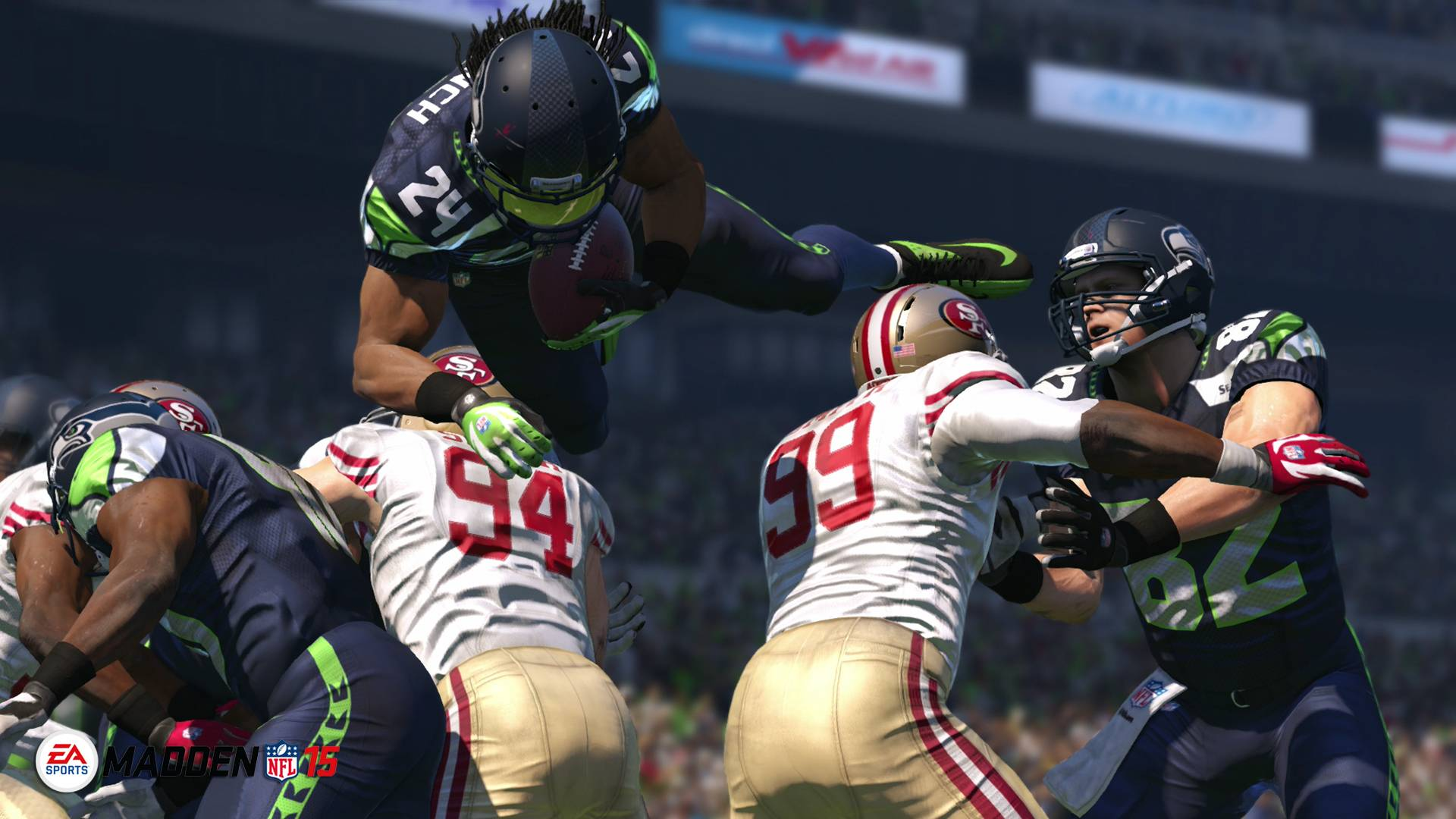"Seattle Seahawks running back Marshawn Lynch leaps for yardage in ""Madden NFL 15."""