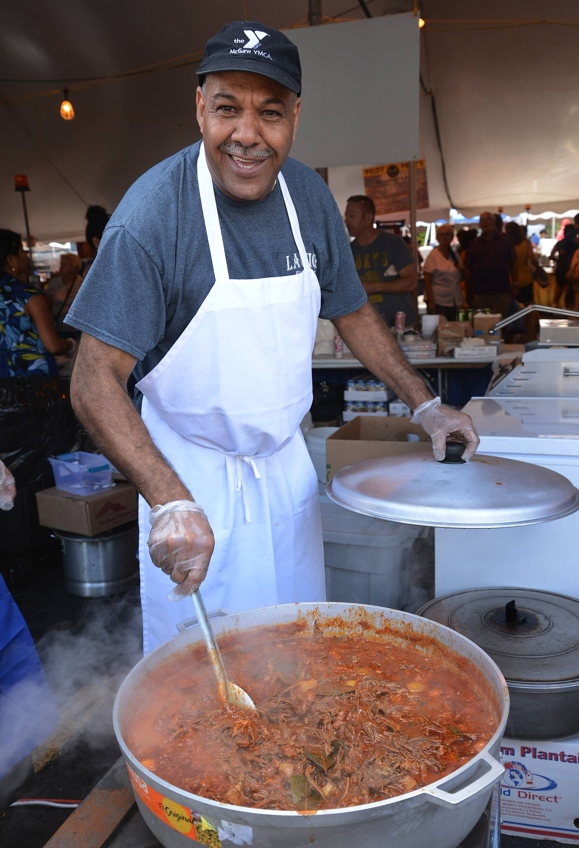 Jorge Reyes of La Unica Cafe stirs up a batch of ropa vieja on the first day of Schaumburg's 44th annual Septemberfest.
