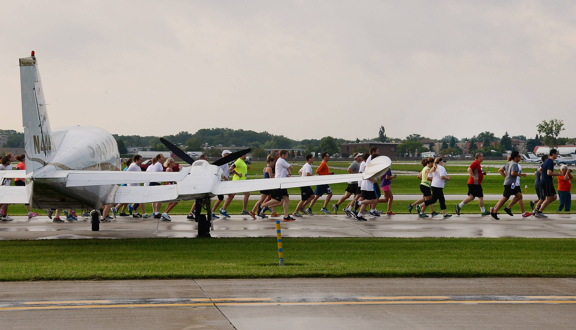 Runners take off down the runway for the inaugural Run the Runway 5K Run and 1 Mile Walk Saturday at Chicago Executive Airport in Wheeling.