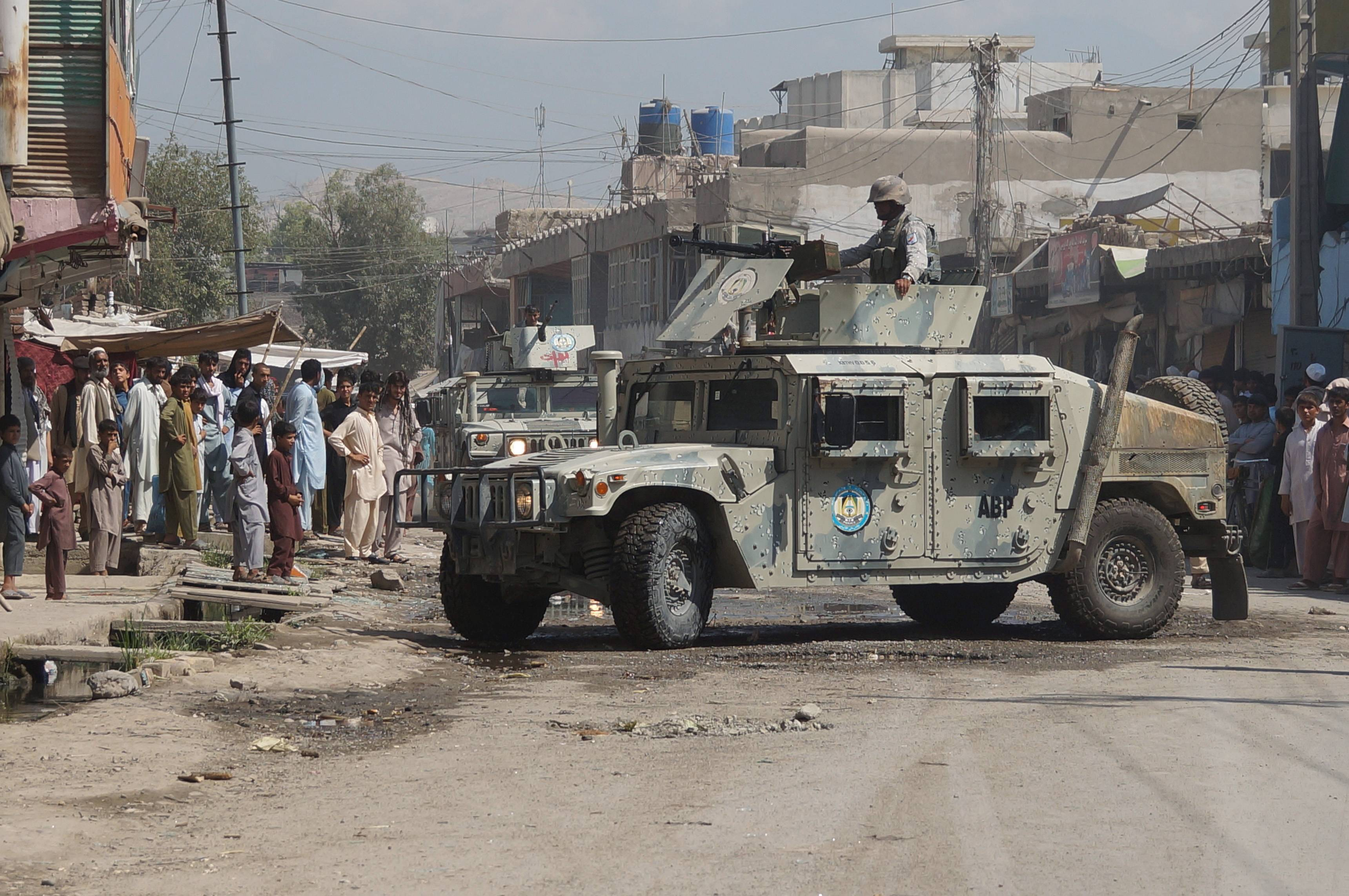 Afghan security forces inspect the site of a suicide attack in Jalalabad, east of Kabul, Afghanistan, Saturday, Aug. 30. A suicide bomber in a truck blew himself up at an intelligence headquarters in eastern Afghanistan, setting off an intense firefight with security forces, officials said.