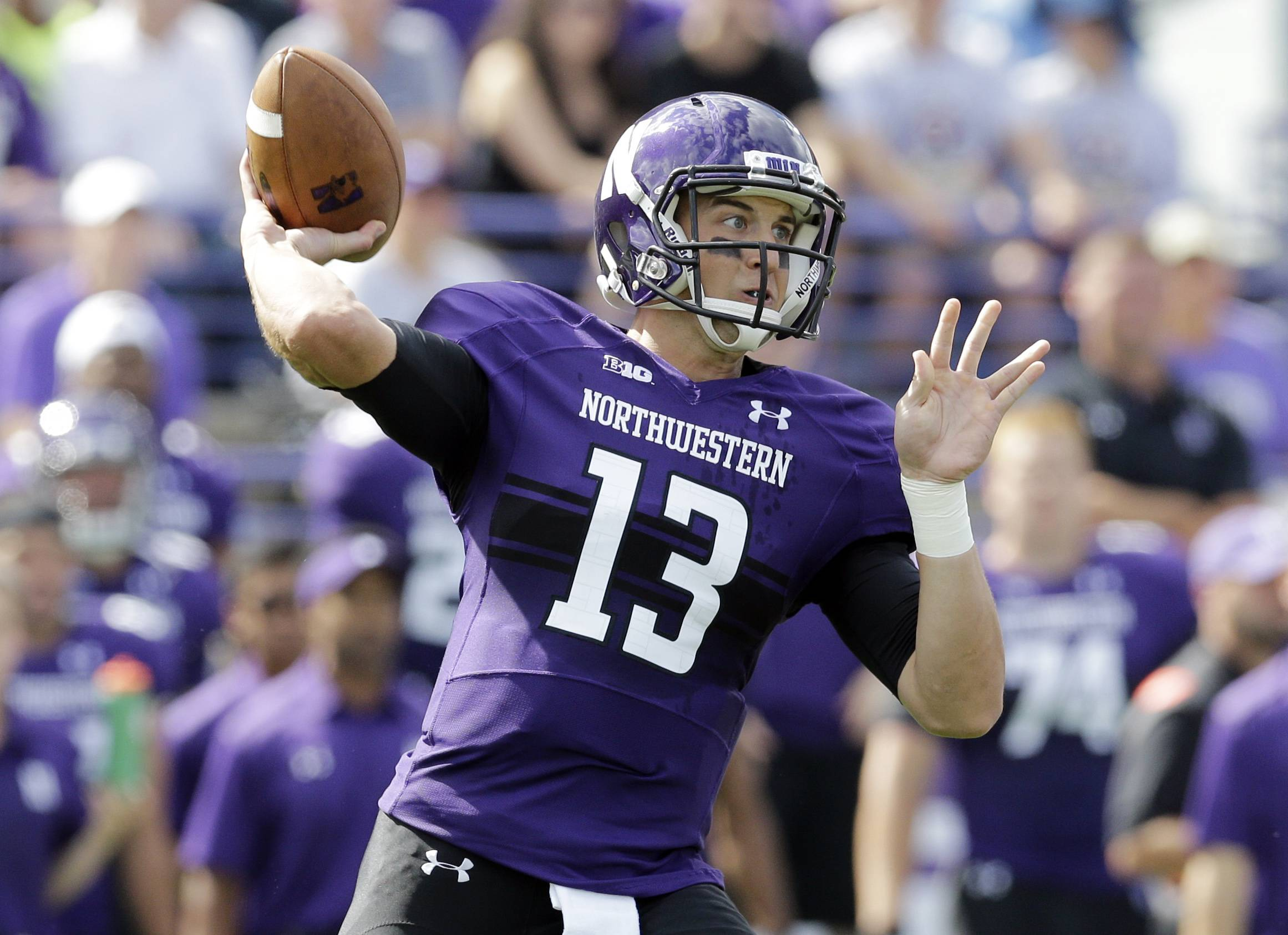 Northwestern quarterback Trevor Siemian (13) looks to a pass during Saturday's game against California in Evanston. The Wildcats lost 31-24.