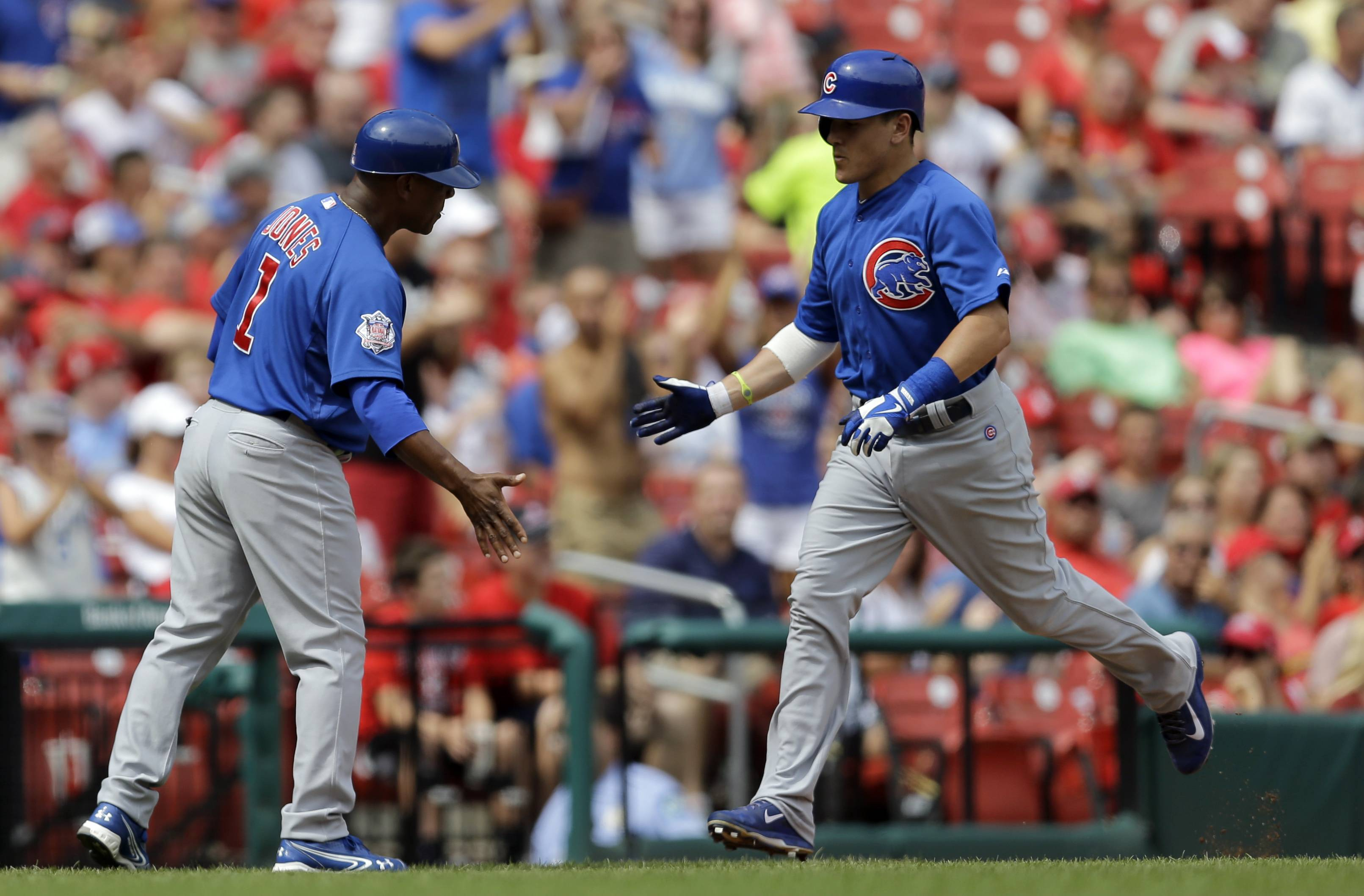 Chicago Cubs' Logan Watkins, right, is congratulated by third base coach Gary Jones while rounding the bases after hitting a solo home run during the fourth inning in the first baseball game of a doubleheader against the St. Louis Cardinals, Saturday, Aug. 30, 2014, in St. Louis.